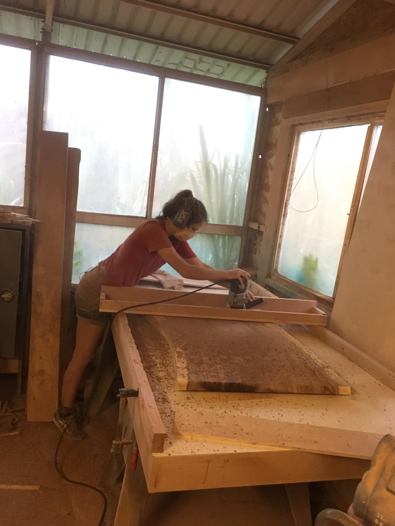 Kristina flattening a coffee table slab