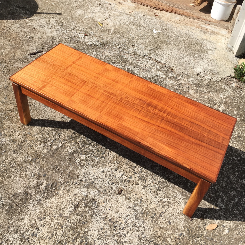 Koa coffee table. Made with curly koa veneer top and solid koa legs.