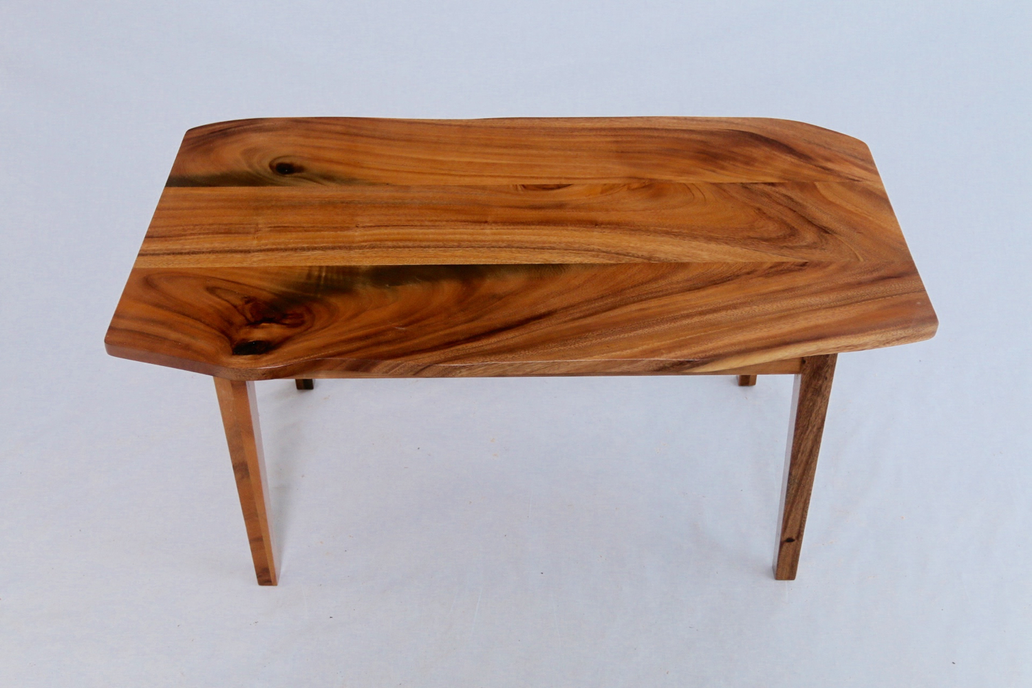 Classic simple monkeypod coffee table. Hint at a natural edge and slim tapered legs.