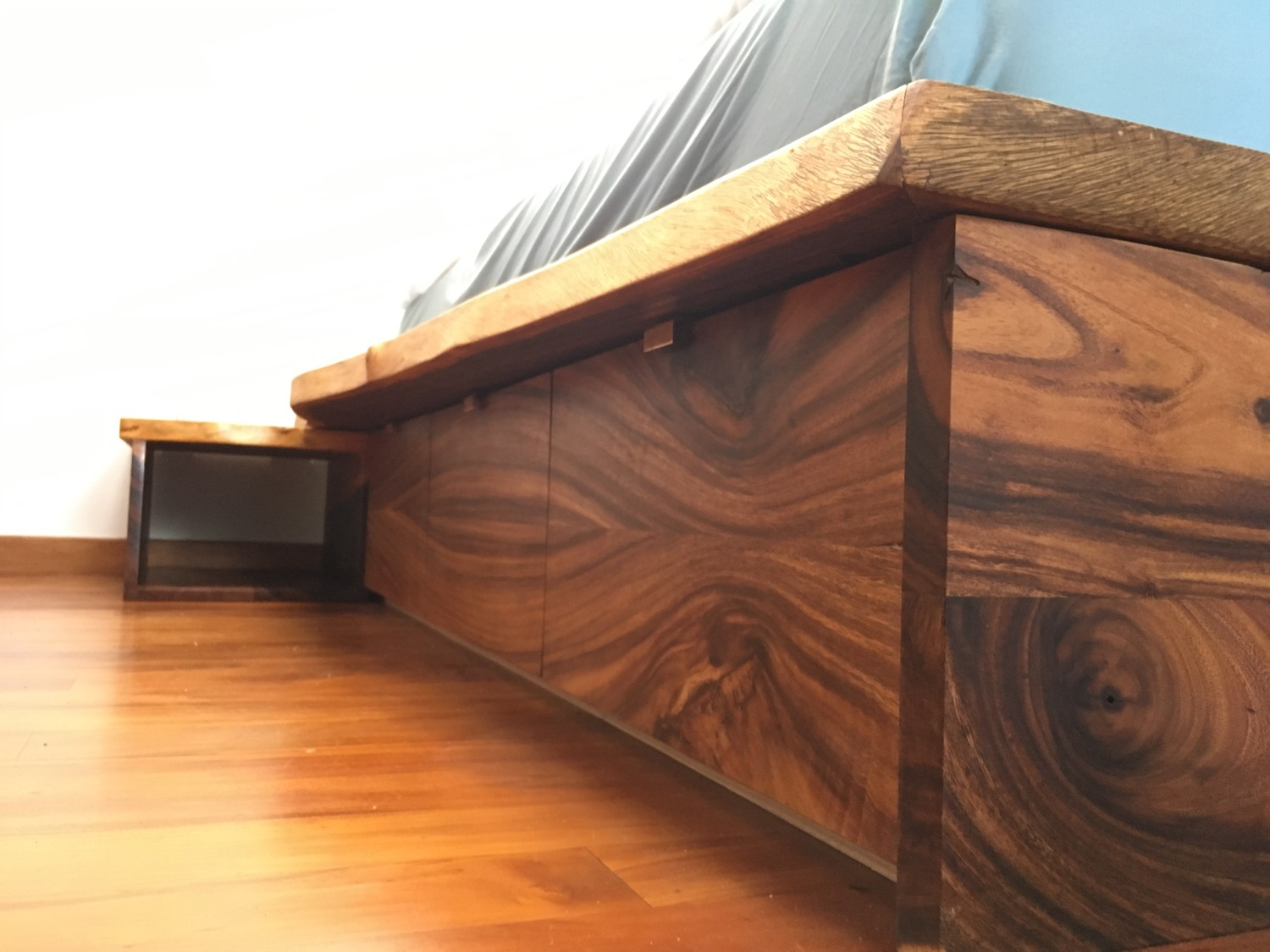 Bookmatched drawer fronts with continuous grain and low profile copper pulls. Drawers run on soft close glides.