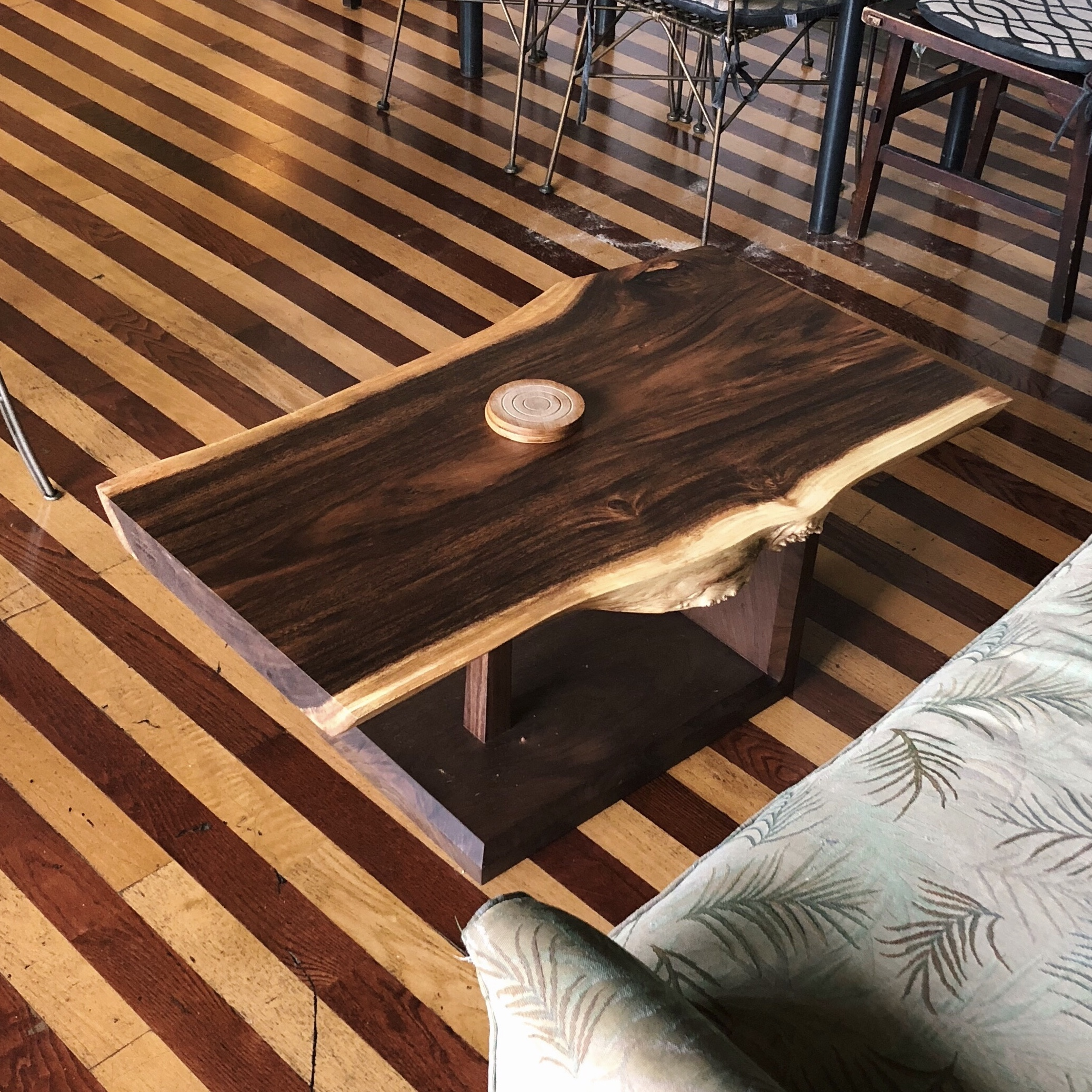Monkeypod live edge slab coffee table with walnut base. This coffee table is in use at the Hawaiian Islands Cafe in Waimanalo!