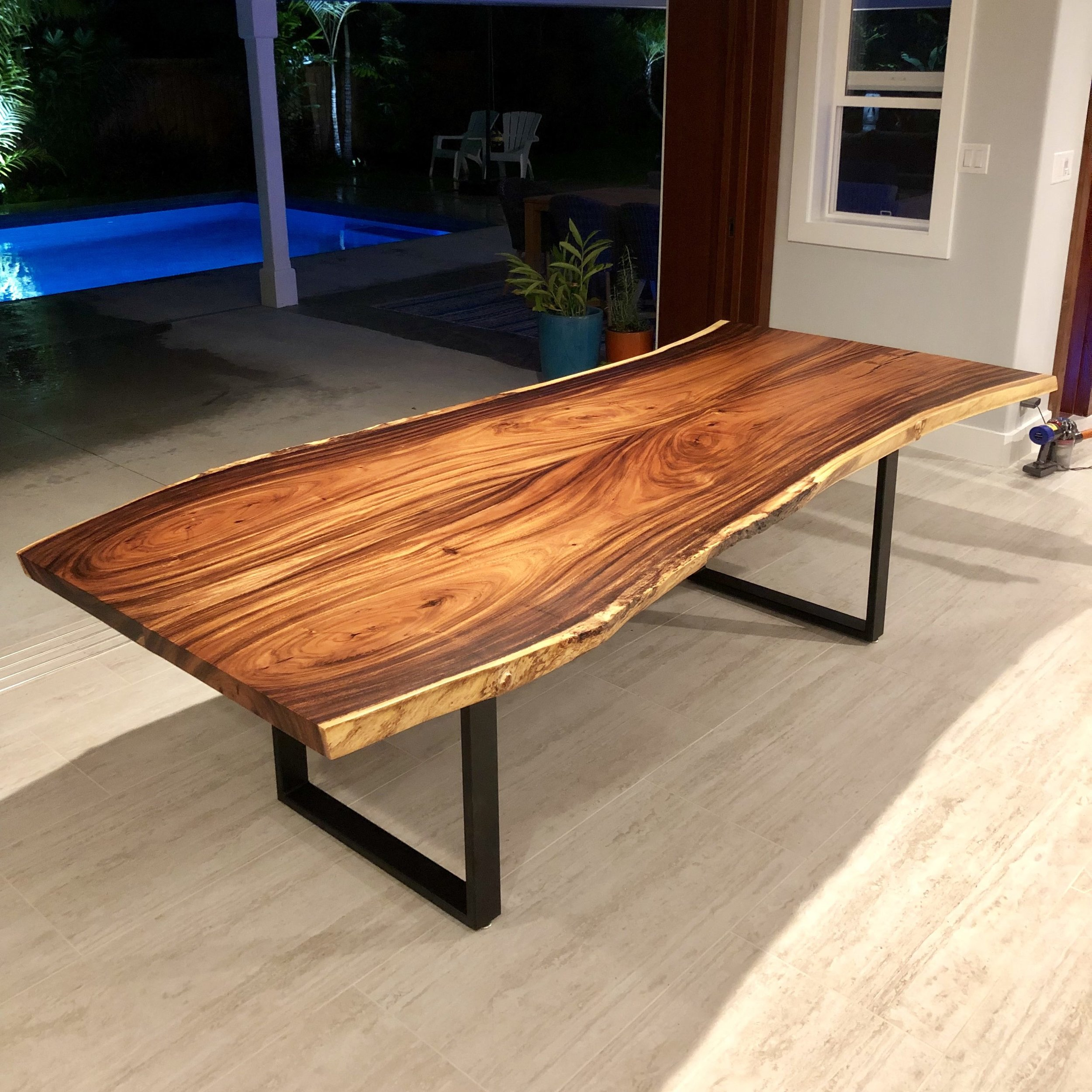 Monkeypod dining table. Bookmatched slabs from a tree in Manoa Valley, Oahu. Steel table legs also made in the USA.