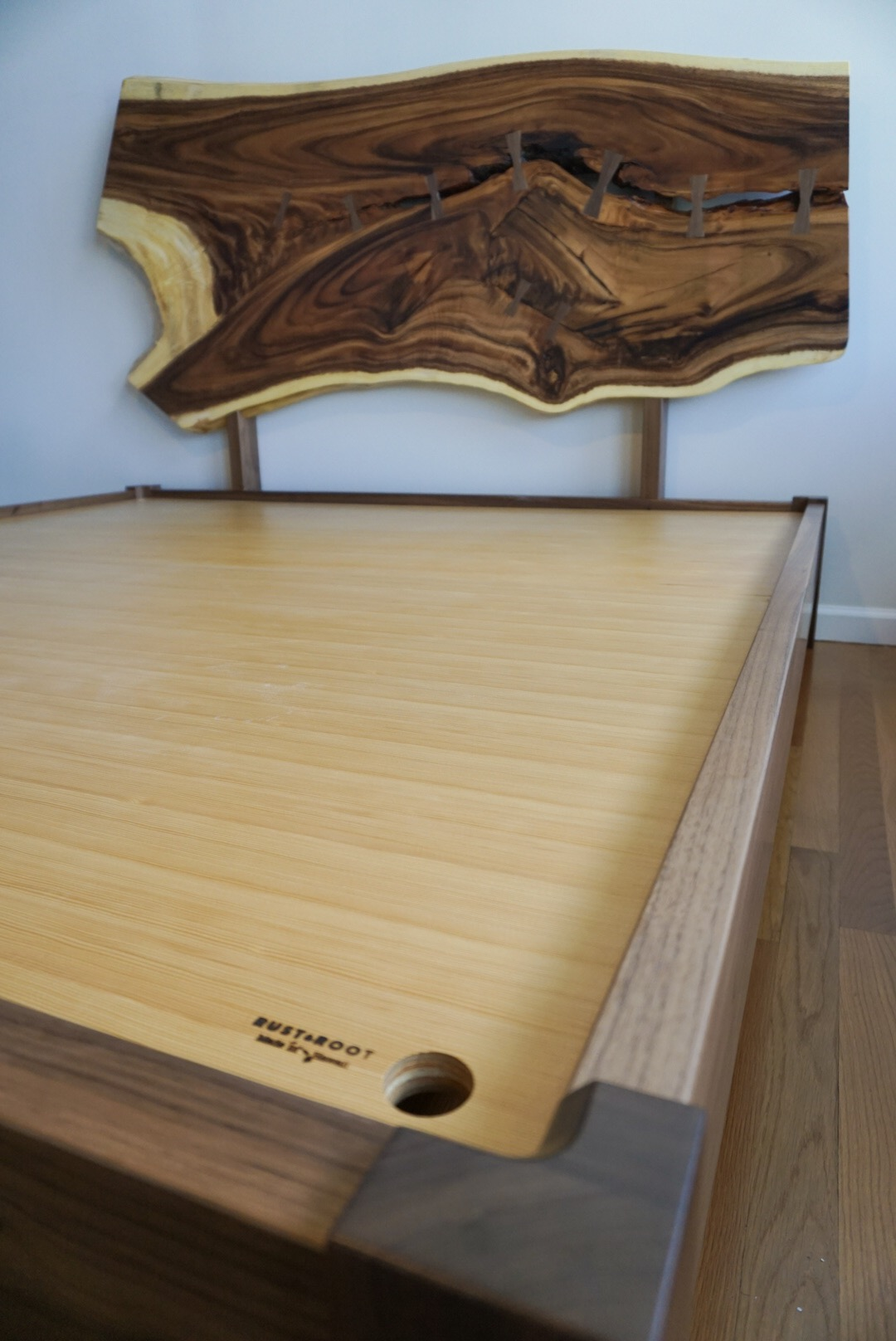 Walnut and monkeypod bed frame. Incredible Hawaiian monkeypod slab with plenty of walnut dutchmen holding it together.