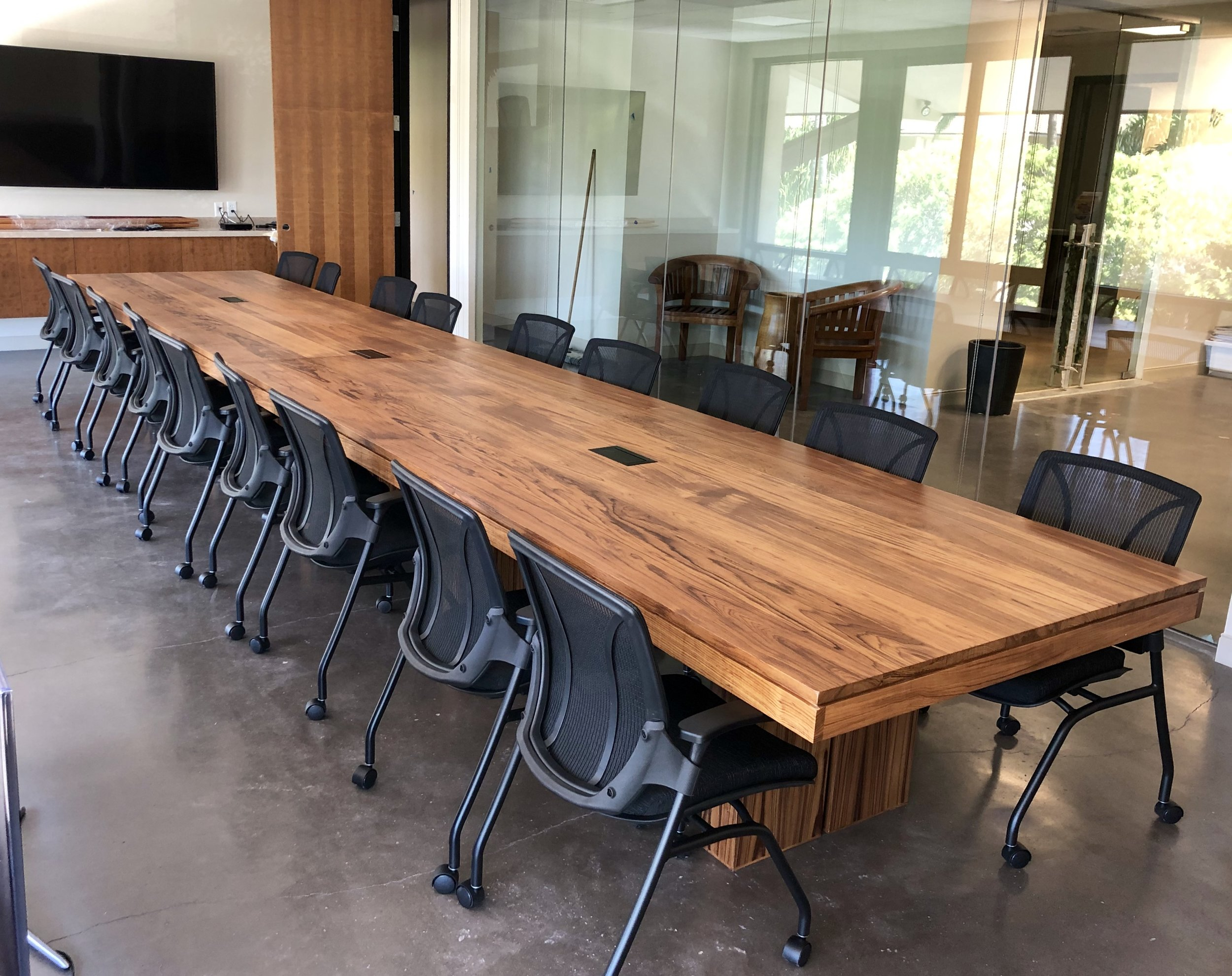 22' long teak conference table.