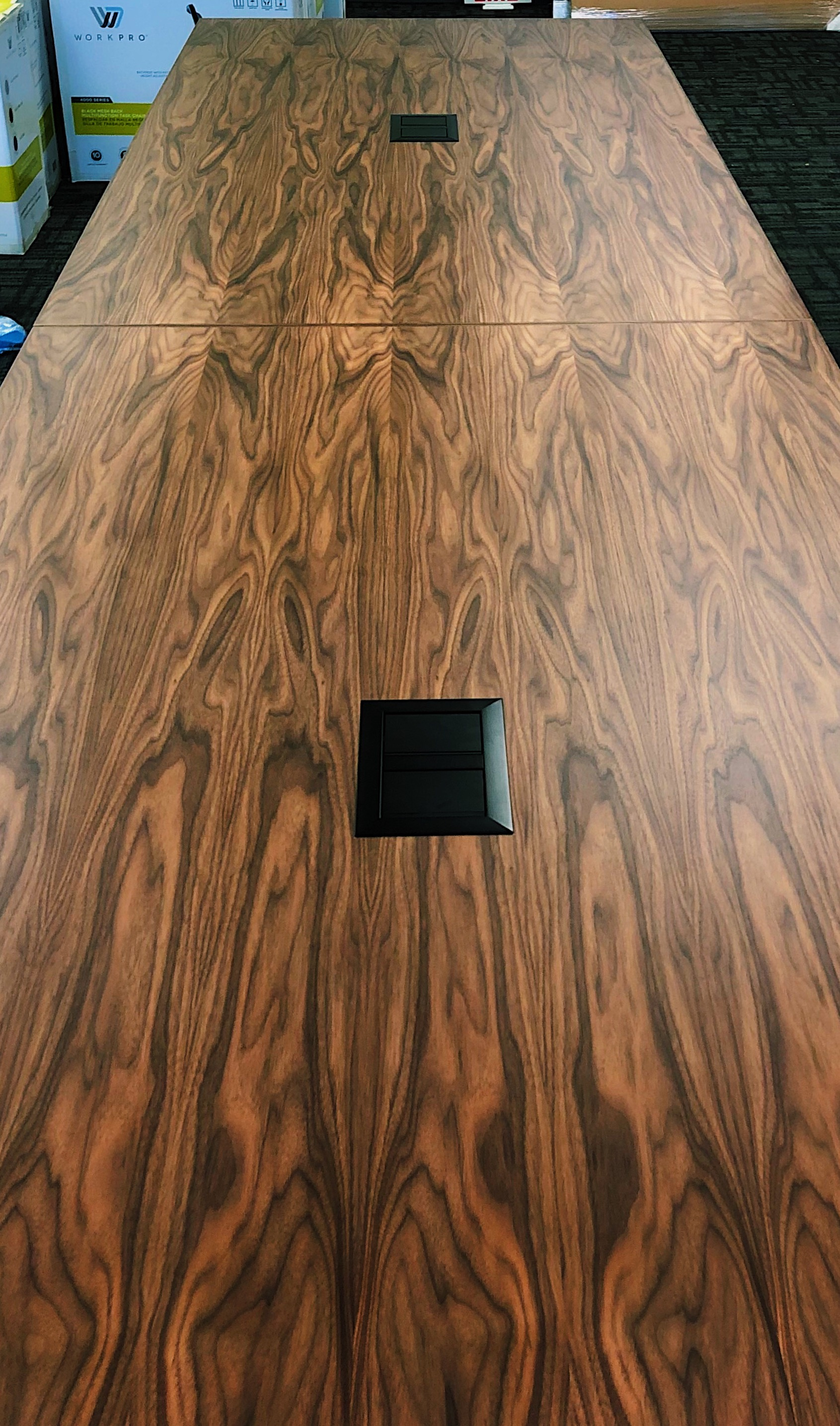 Walnut conference table with Mockett media ports