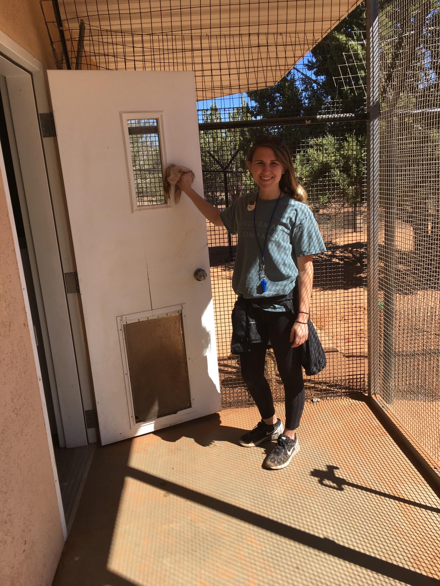 Hannah Cleaning Stetsons Door.JPG