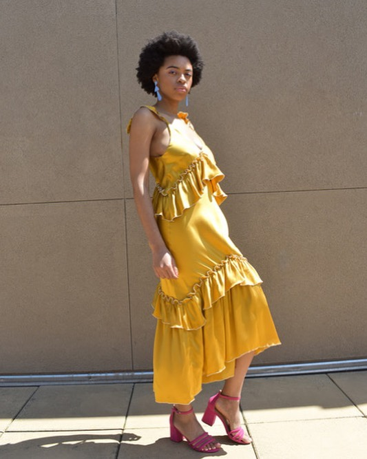 The Lilith Convertible Slip Dress in turmeric silk chanteuse // available now at @insupportof // learn how this dress transforms into three additional garments on ISO Mag (link in bio👆) . Photo courtesy of @insupportof Model @tanyaangelique