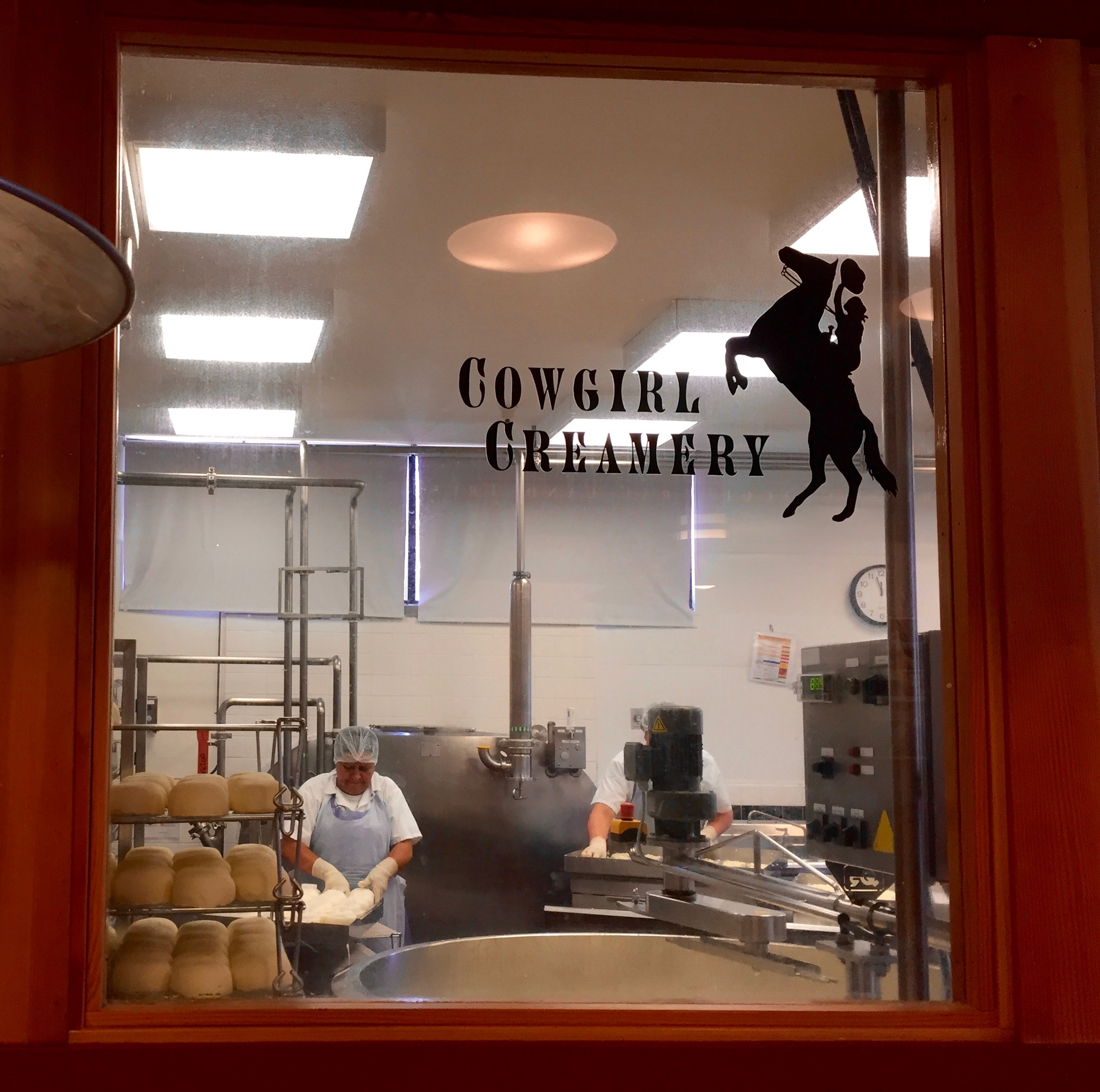 A cheesemaker in action at Cowgirl Creamery. Mt Tam triple cream, please!