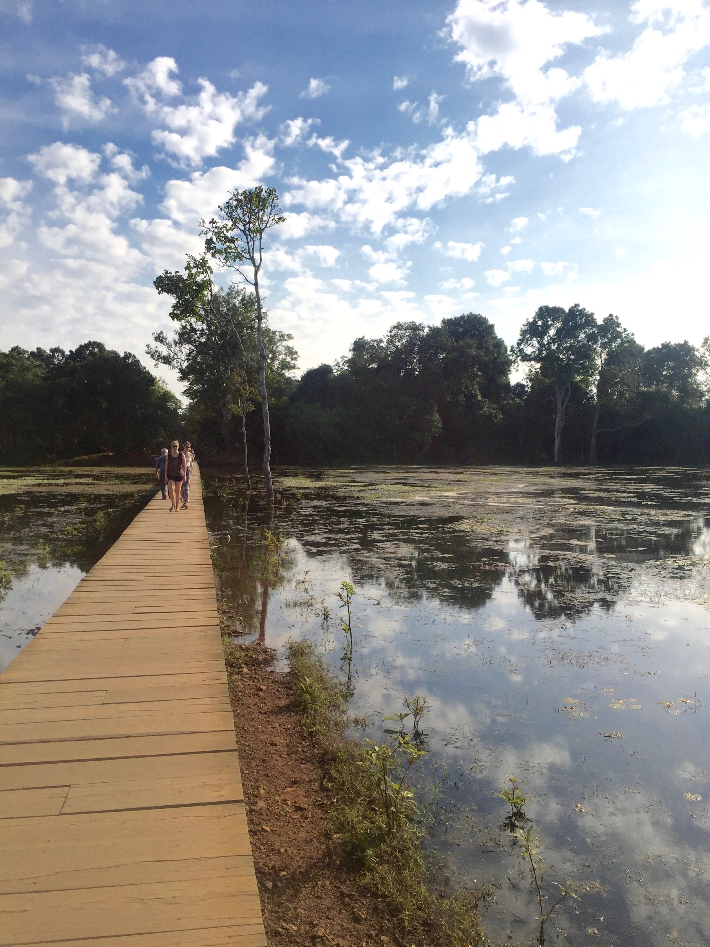 A narrow boardwalk leads you to Neak Pean, the island temple.