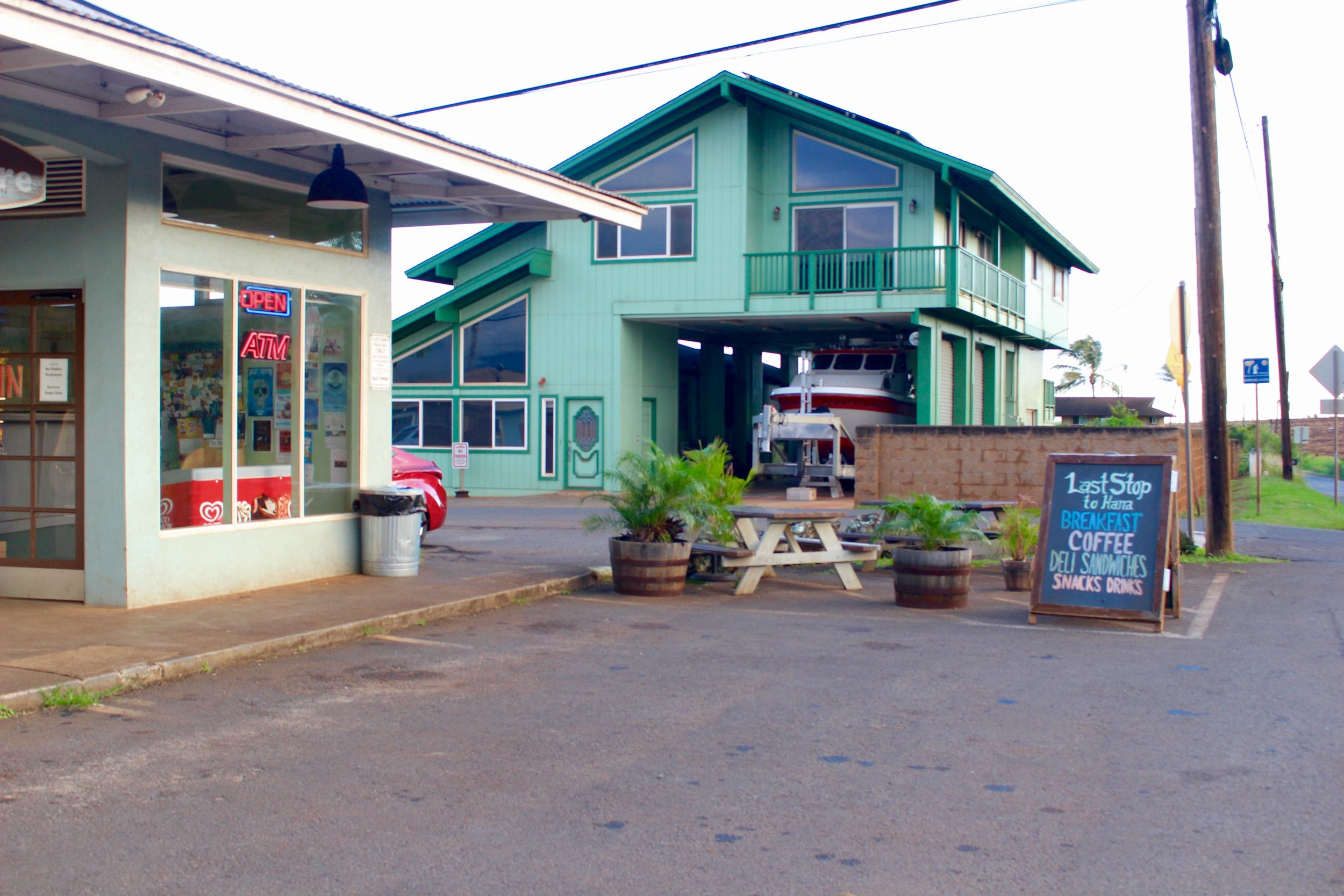 """This sign reads """"Last Stop to Hana"""" outside the Kuau Store in Paia. Pick up lunch and some snacks for the ride."""