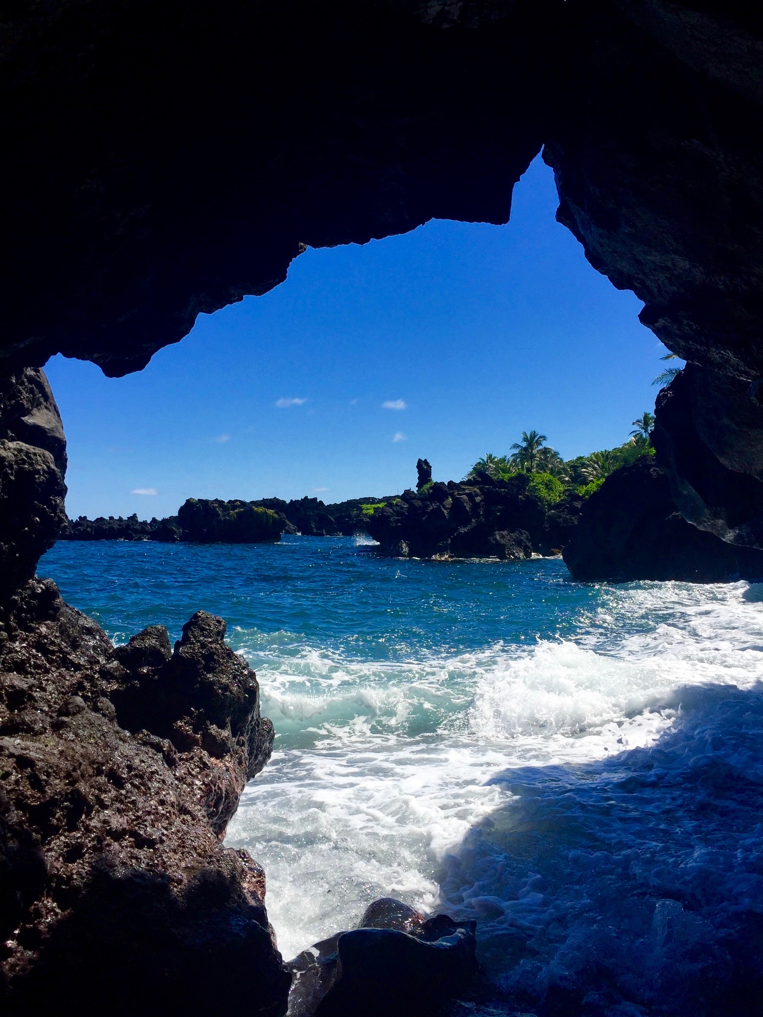 A lava tube cave on the ride side of the beach.