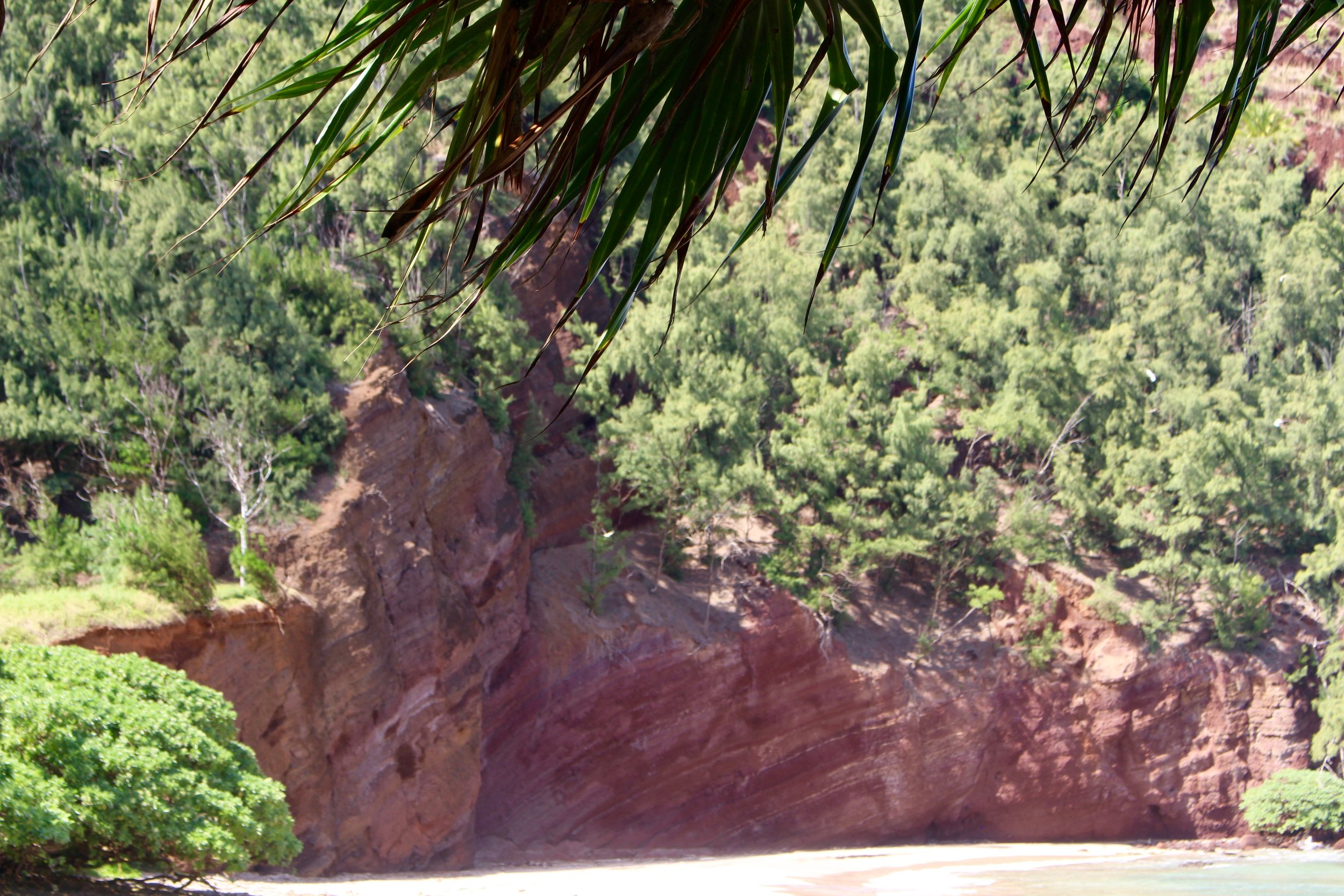 These rocks tower over Koki Beach and turn the sand a shade of red.