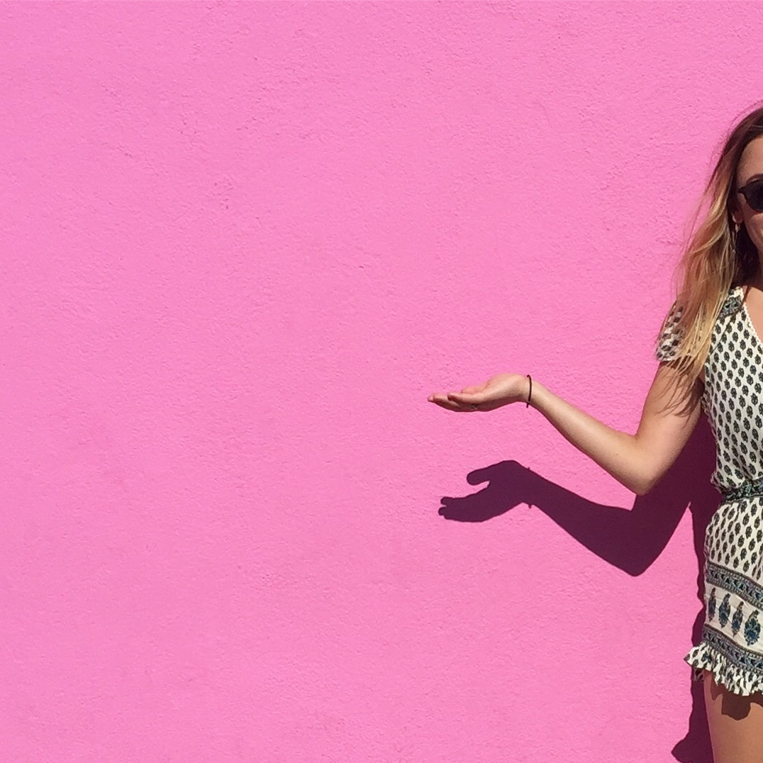 It's a very pink wall. You can find it at  8221 Melrose Ave in LA . I recommend taking off the hair-tie around your wrist for your own picture :). (August, 2016)