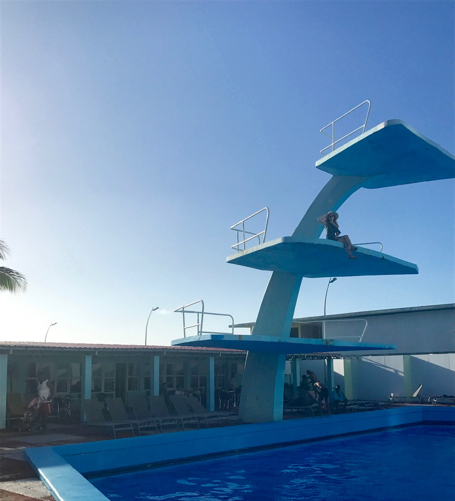 Climbing the high dive at Hotel Riviera.