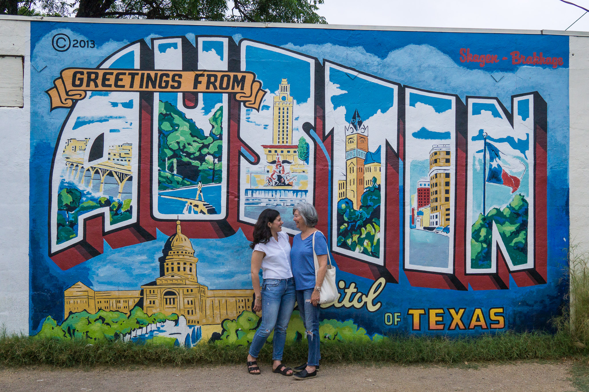 Morgan and her Mom at the Greetings from Austin mural.