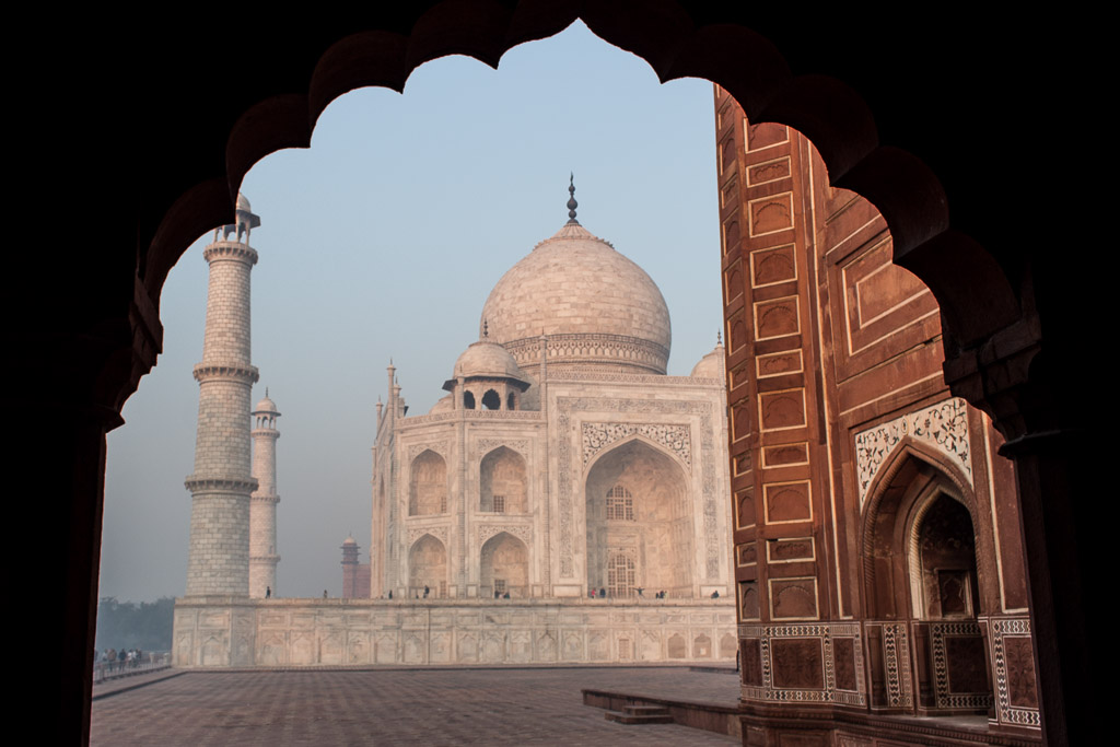 Standing under the gorgeous arches at the wall to the right of the Taj Mahal.