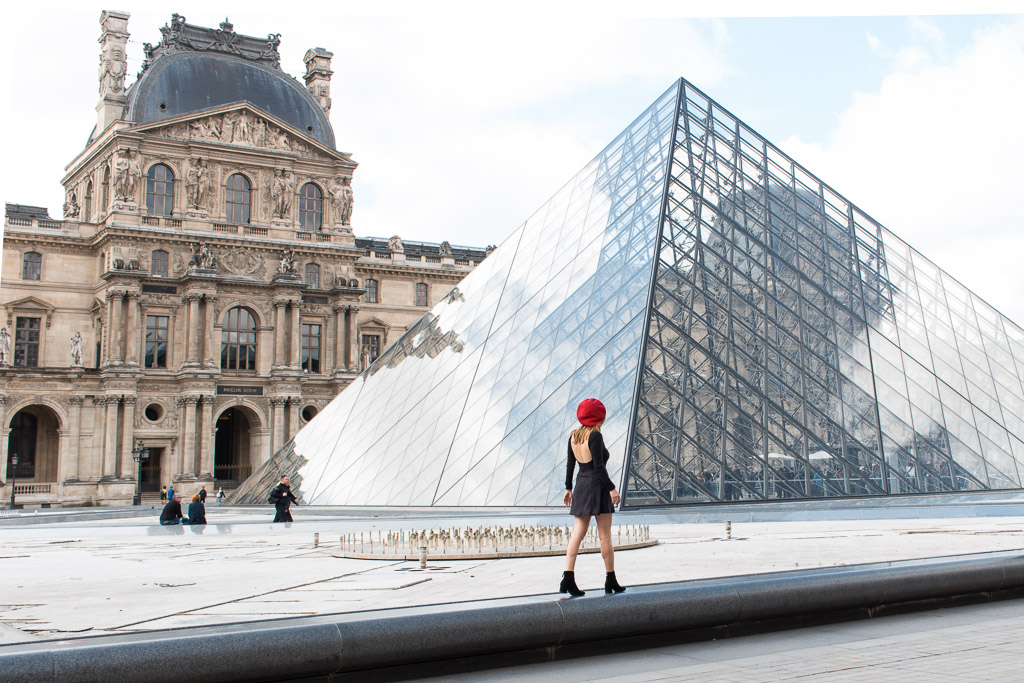 The largest pyramid in the main courtyard outside the Louvre.