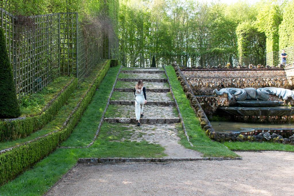 Skipping through the gardens of Versailles.