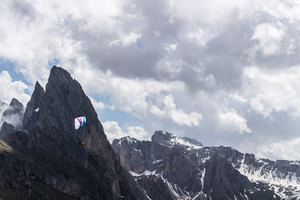 A paraglider flying over Seceda.