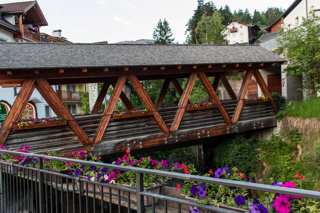 A beautiful wooden bridge in the town of Ortisei.