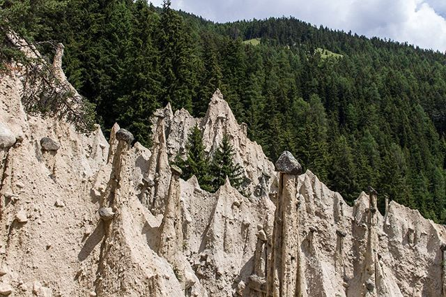 The Earth Pyramids of Platten were formed by extreme climate and natural erosion. They're hidden in a forest in Northern Italy but you can hike to them in about 30 minutes. #earthpyramidsofplatten #dolomites #dolomitesitaly