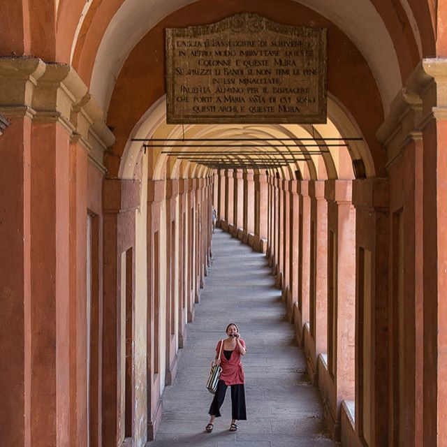 After hiking in the Dolomites, we spent 3 days in Bologna. The entire city is covered in porticos, these covered sidewalks. One of the coolest things to do in Bologna is walk under the 666 porticos that lead up to the Sanctuary of the Madonna di San Luca. At the top you'll find the most beautiful views of Bologna (swipe right 😉). #bologna #italy #porticos #twobluepassports