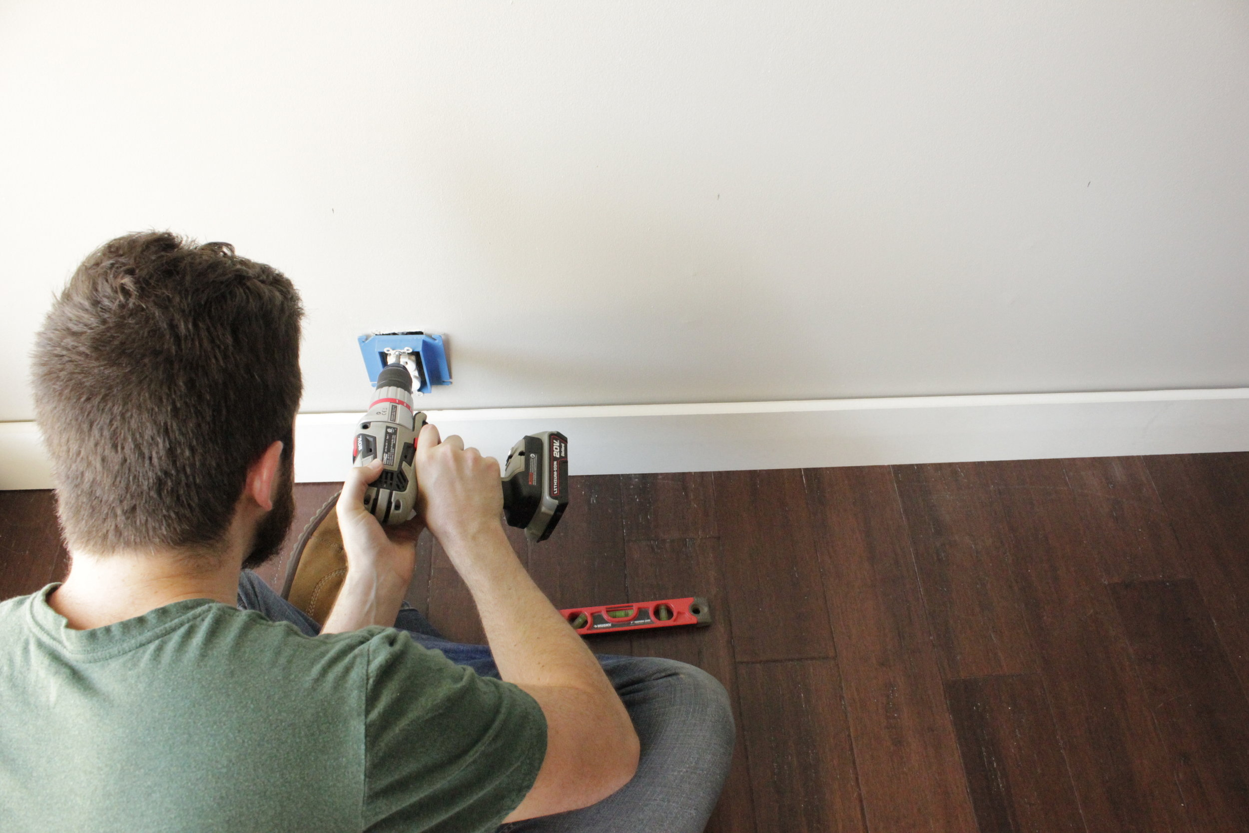Installing the outlet extenders.