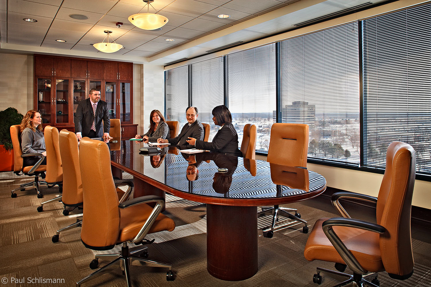 Milwaukee corporate photographer | Group action shot in conference room