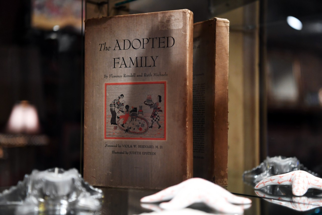"""The Adopted Family"" is displayed in Laura and John's home. They adopted their son, Jonathan, in 2002 from Guatemala. It took months to finally bring Jonathan home after the attorney on the case committed adoption fraud. Laura's daughter Natalie also has an adopted son, Tucker."