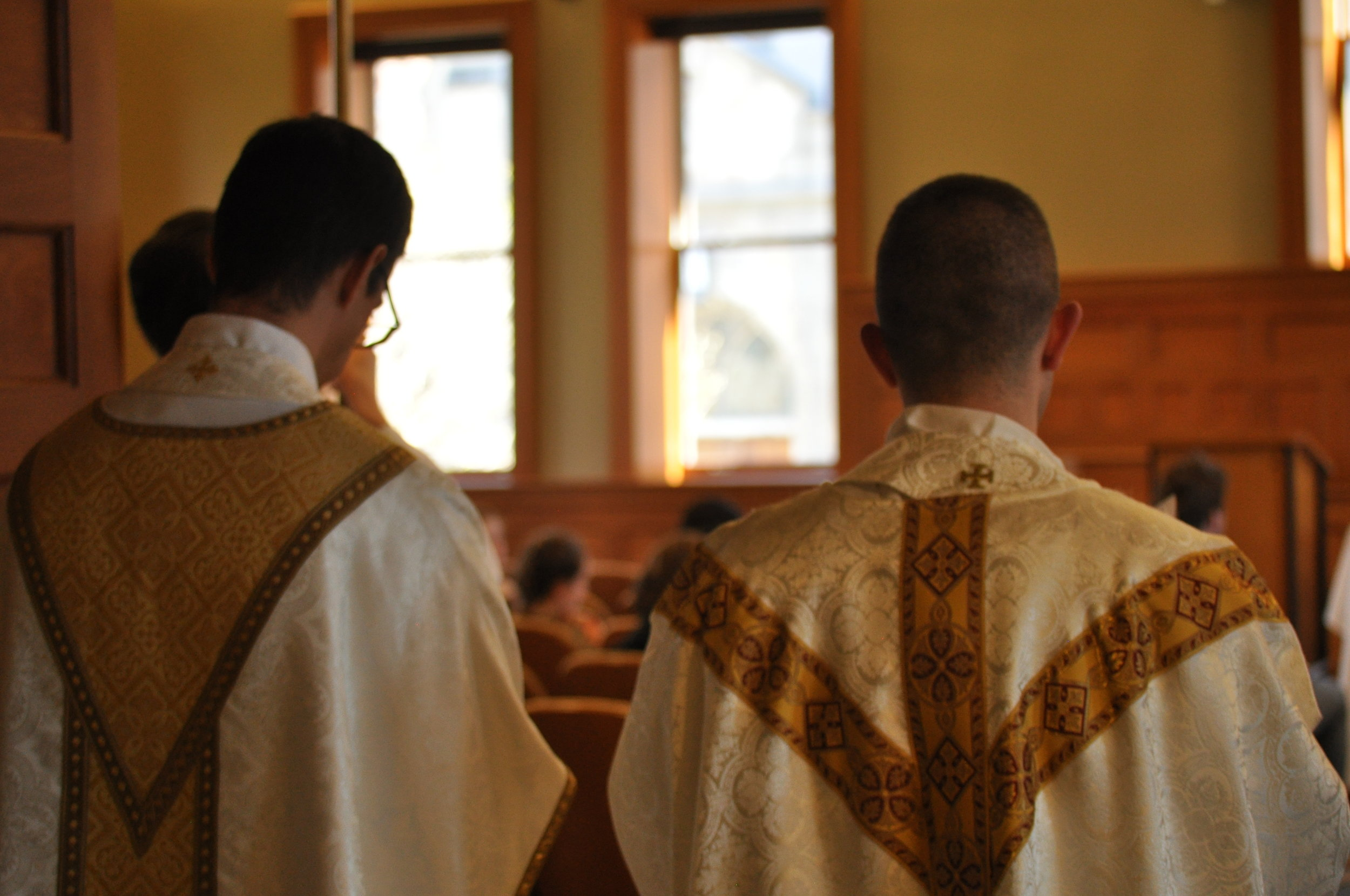 Fr. Kyle Kilpatrick and Fr. Nick Monco prepare for Mass.