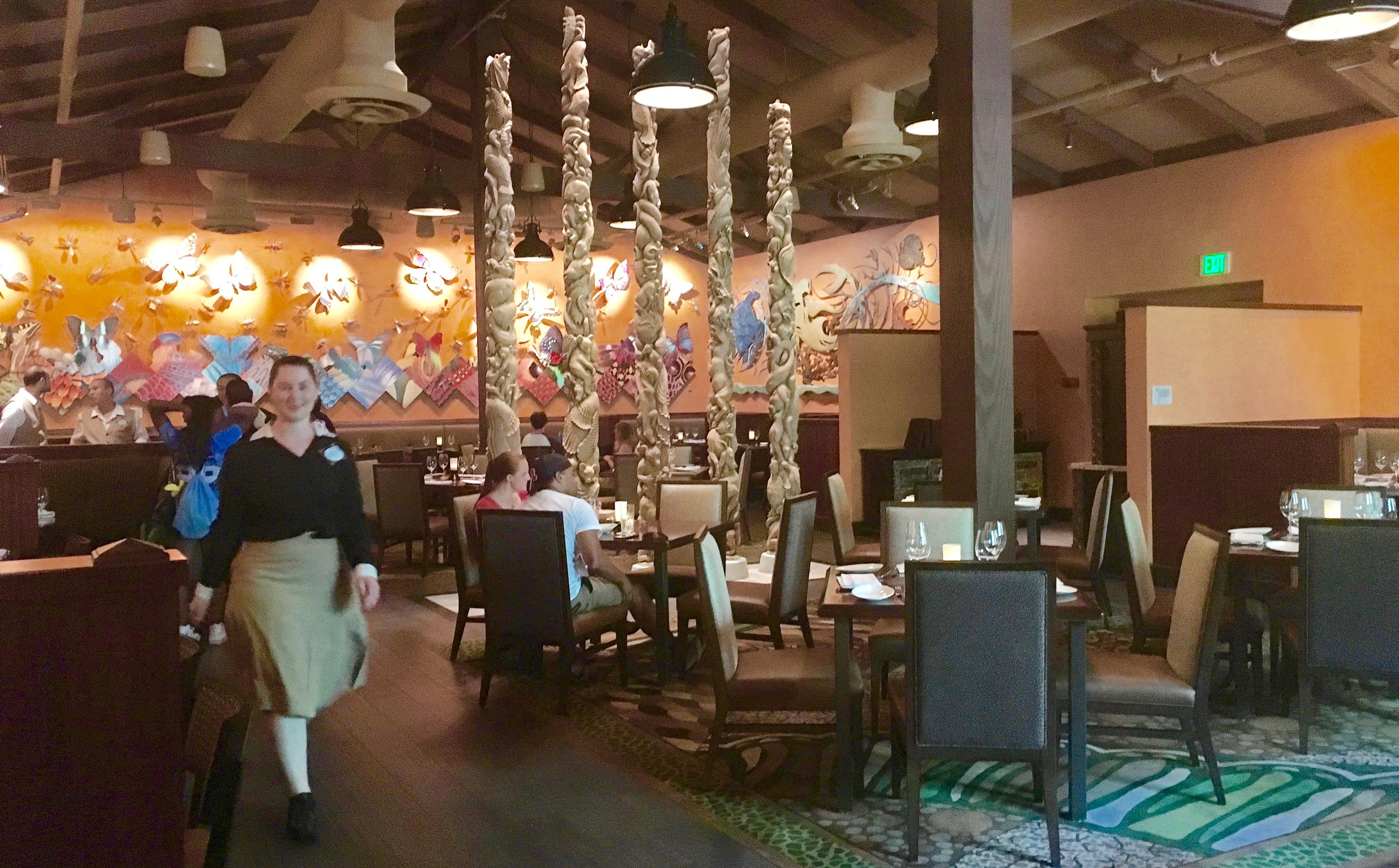 This Tiffins dining room has hand-carved totem poles from Bali in the center
