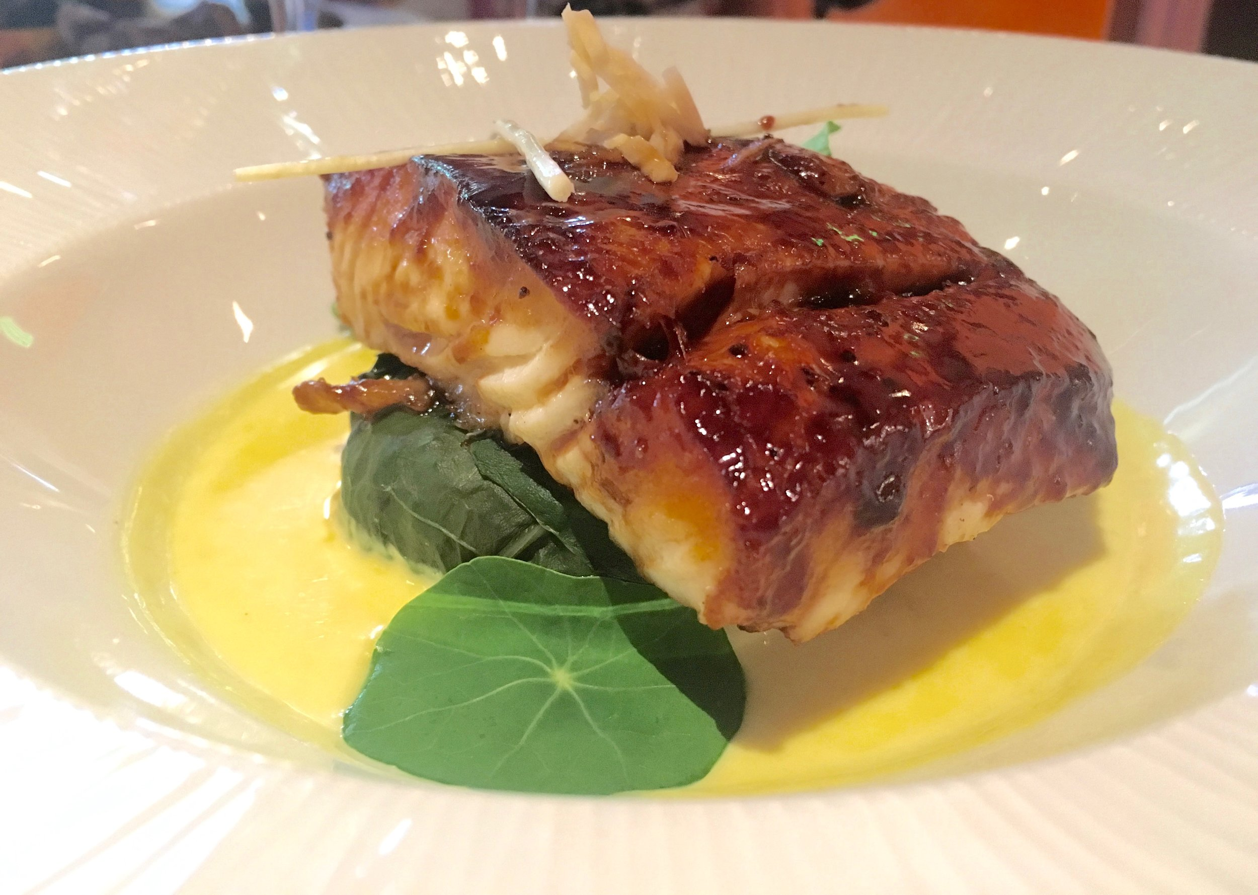 """Hoisin-glazed halibut with """"forbidden"""" rice, swiss chard and turmeric sauce at Tiffins"""