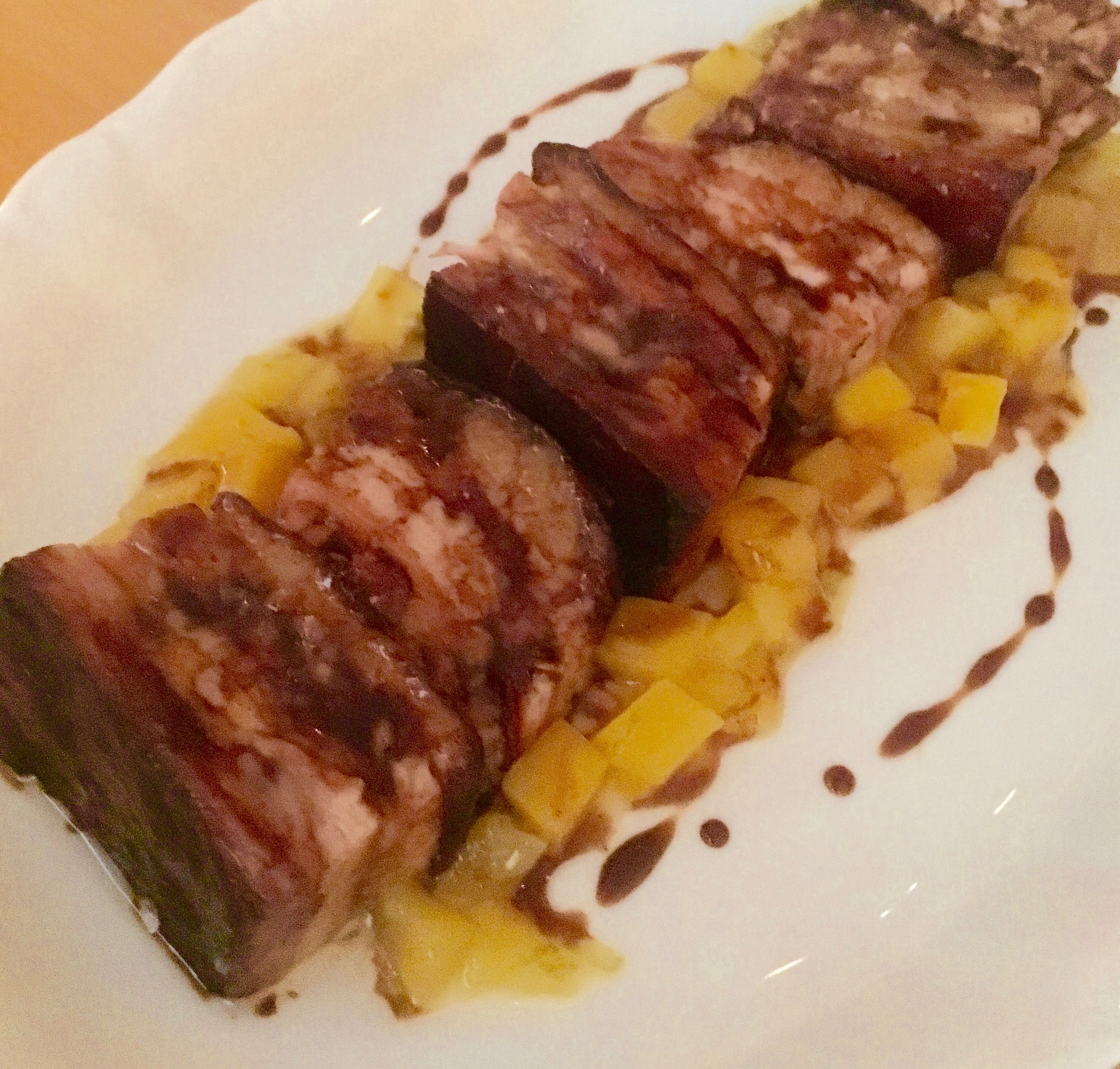 "I should be banned from taking food photos. This ""rhum & pepper painted"" pork belly with lime-marinated mangoes was carmelized and meaty and fruity and ... just so good. Not a good likeness, though."