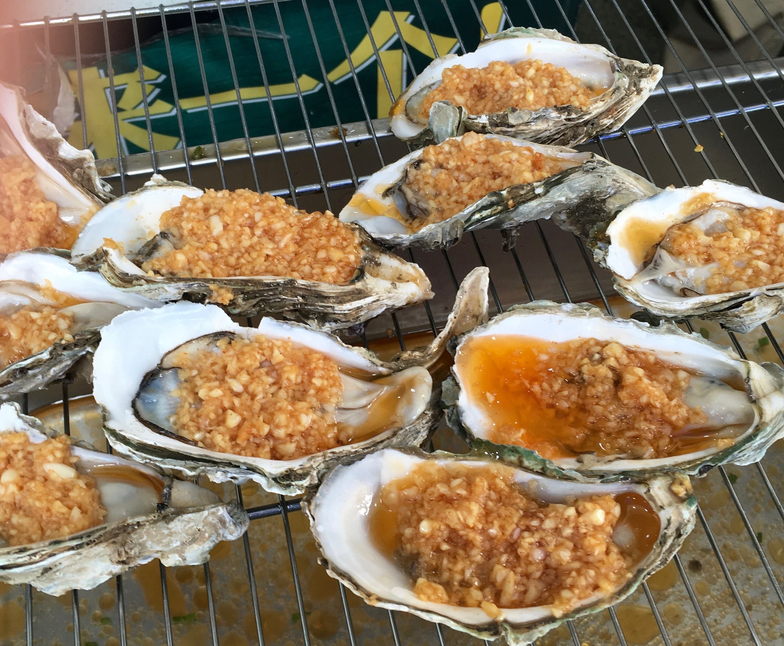 Oysters, apparently, with minced something-or-other--do I eye garlic?--on top