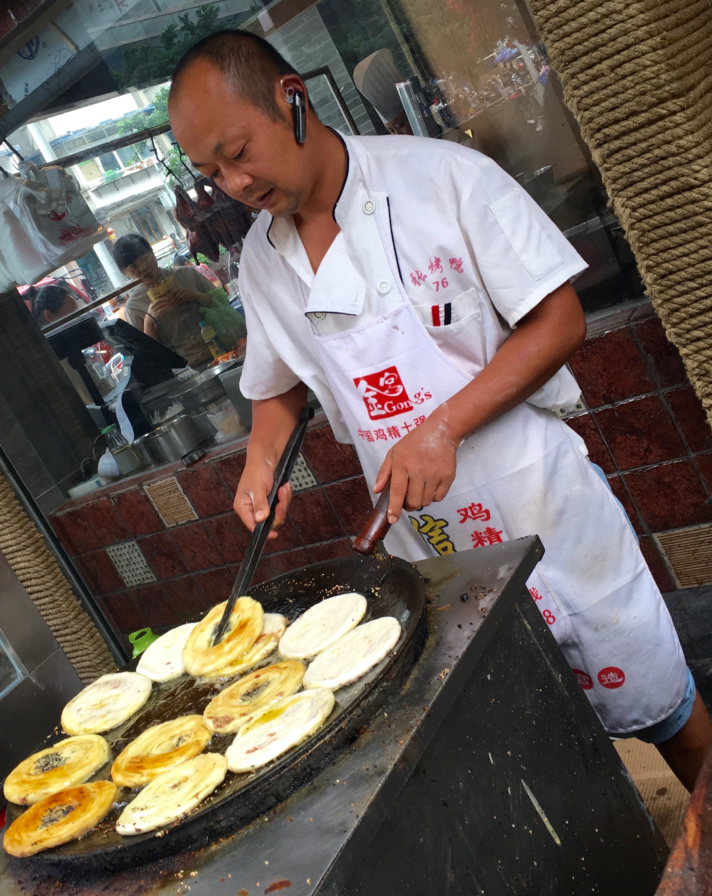 Here's the cook, bringing them to a sizzle along the sidewalk.