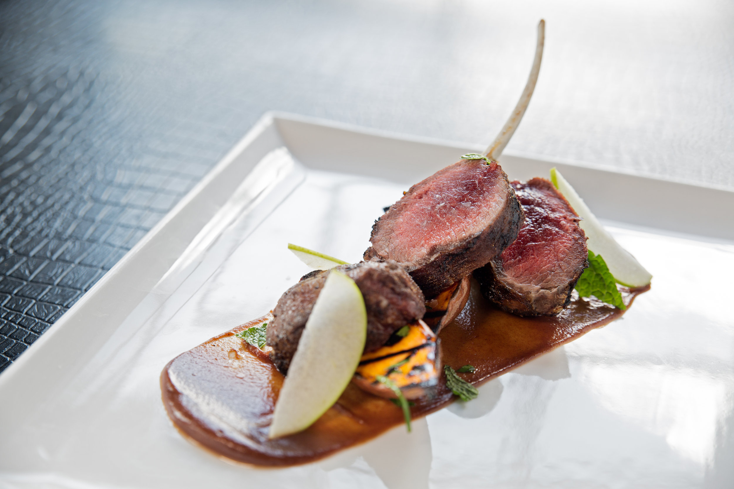 Spice-rubbed rack of lamb with sweet potato, shaved apple and date chutney