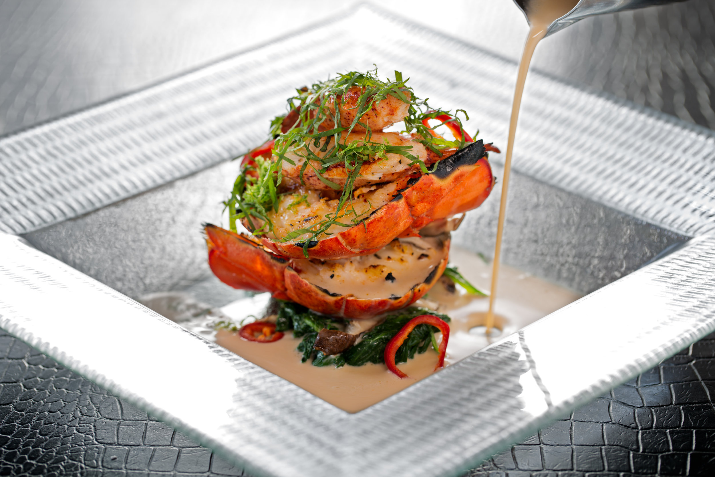 Grilled Maine lobster with shiitake mushroom, red chiles and ginger-coconut broth