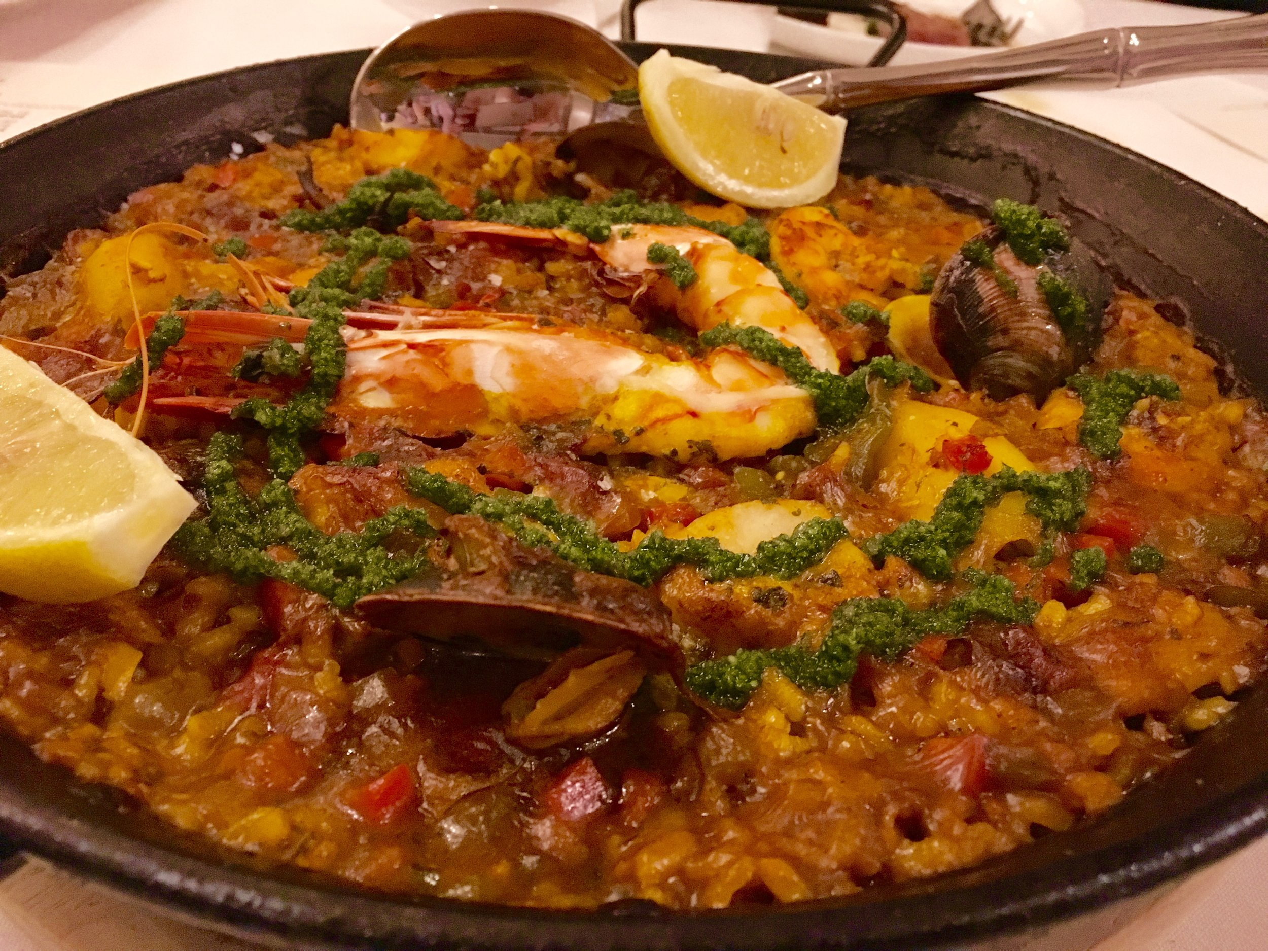 I'm kind of burnt out on paella in general because most are made so poorly. This one is an exception. The saffron rice is al dente yet creamy, somehow, with a smokey underlay. It's loaded with shellfish and topped with red sofrito and an herb sauce.