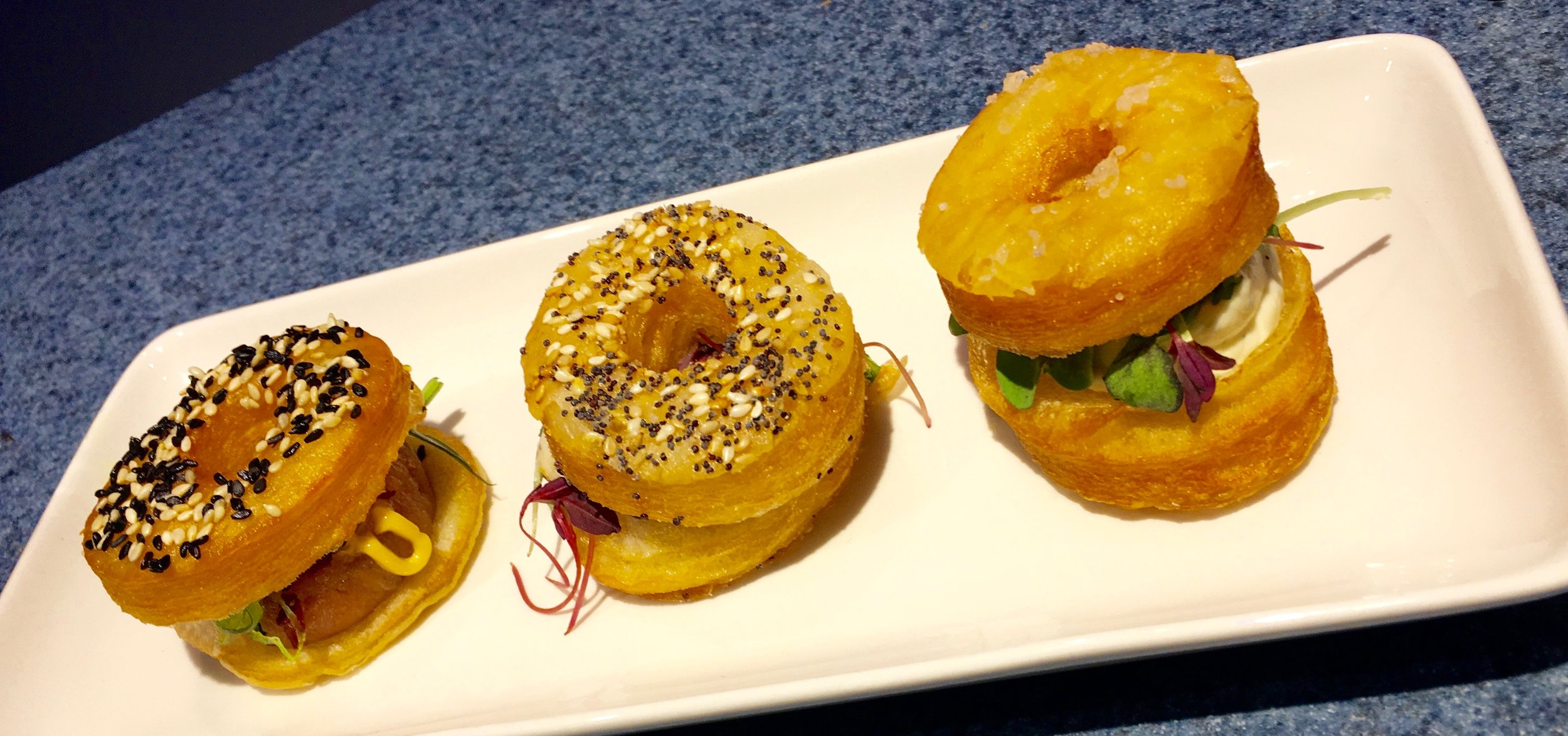 I absolutely loved these savory sandwiches. They're called Croissant Doughnuts and they're filled with herbed whipped cream, chicken mousse, or spicy tuna with Sriracha mayonnaise. They're sold at The Painter's Palate.