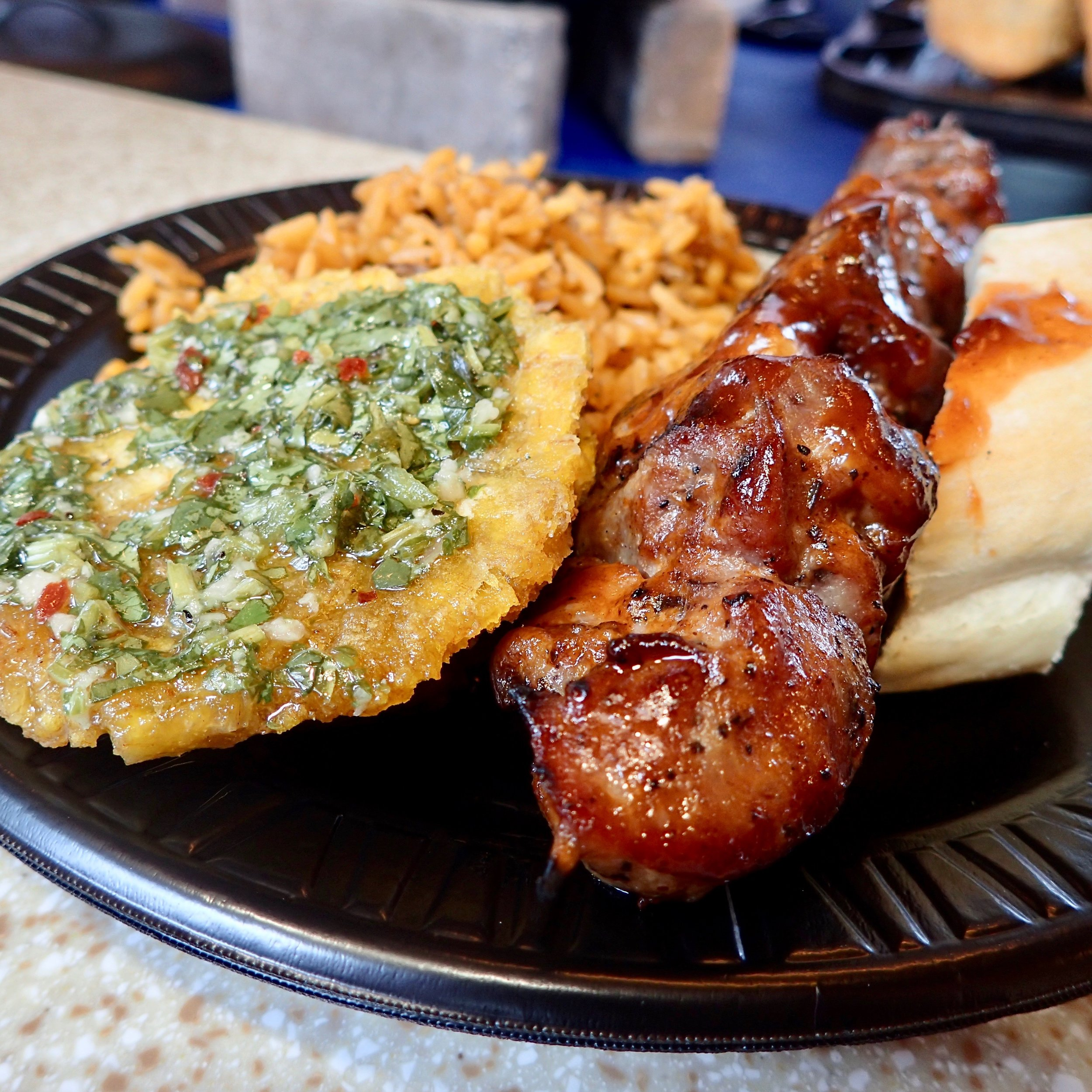 Gorgeous, right? This is the pincho de pollo (or may it's the cerdo?) con tostones -- in other words, a chicken or pork kebab platter served with fried green plantain, rice and bread.
