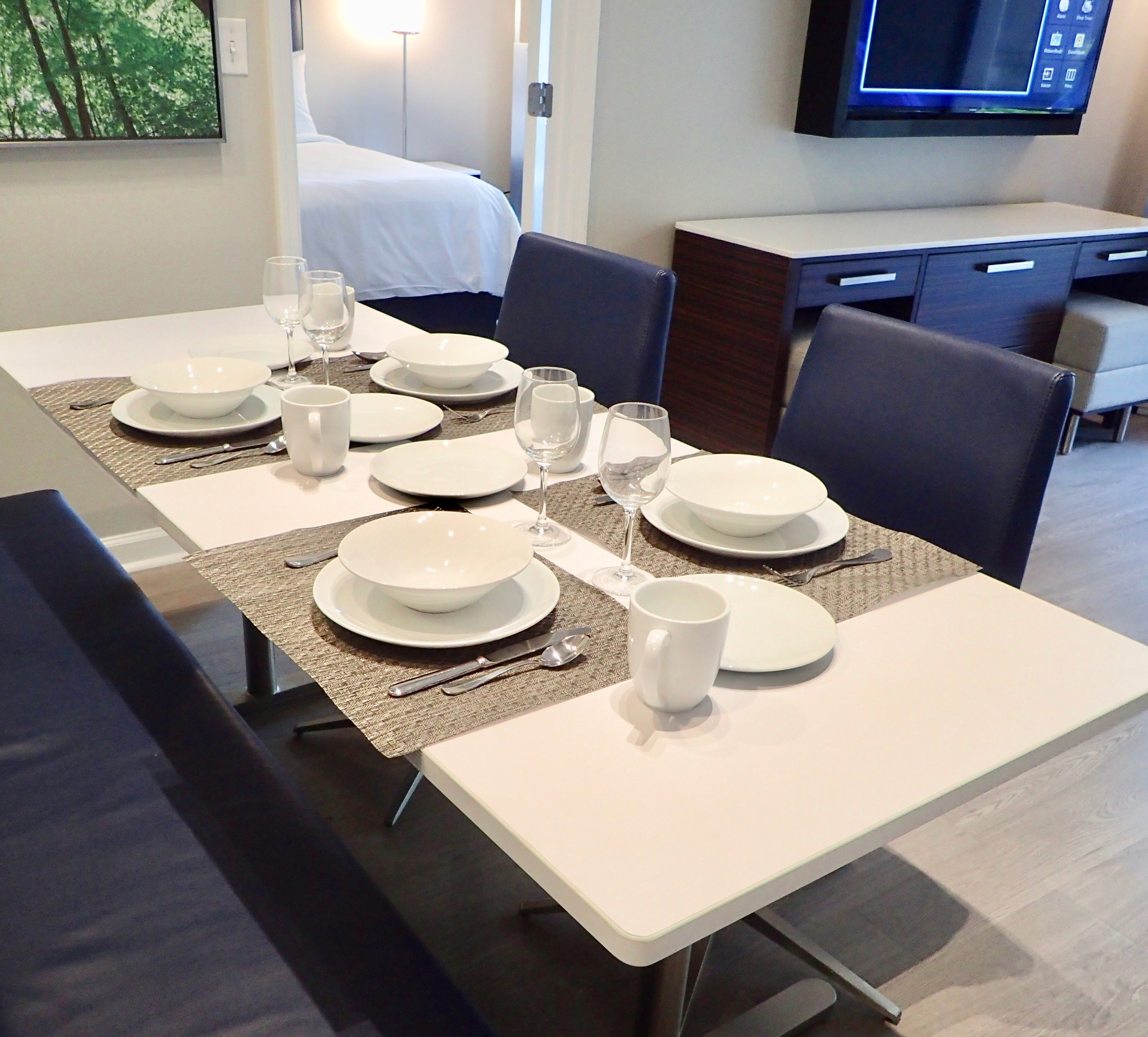 Dining area in a typical Grove Resort and Spa condo unit, with a bedroom beyond