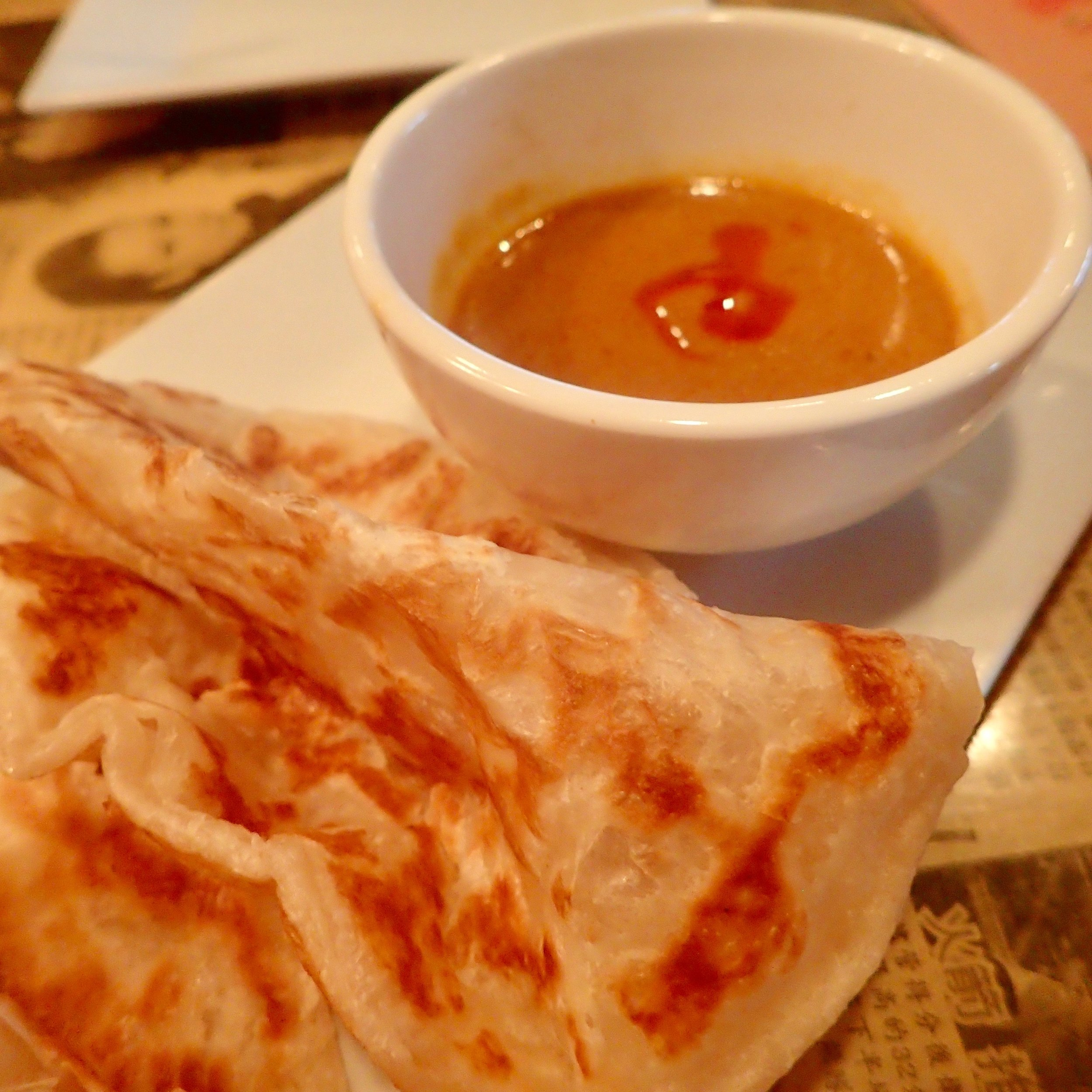 Roti Canai -- a staple since Day 1. It's a flaky bread served with a rich curry sauce dip, and another one of my family's must-haves. We order it with extra pancakes.