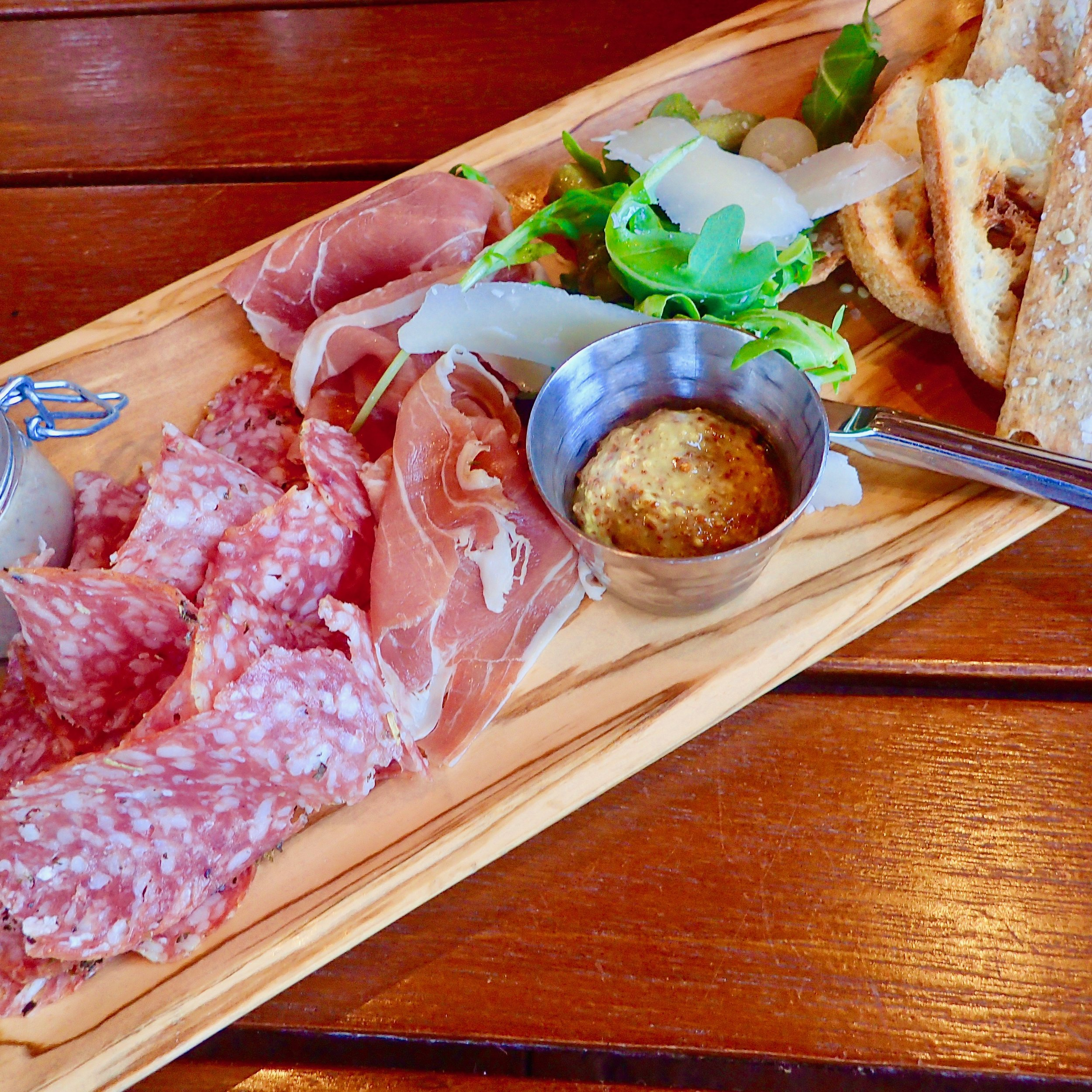 Hand-crafted charcuterie platter with prosciutto, duck rillette and lavosh. Geyser Point