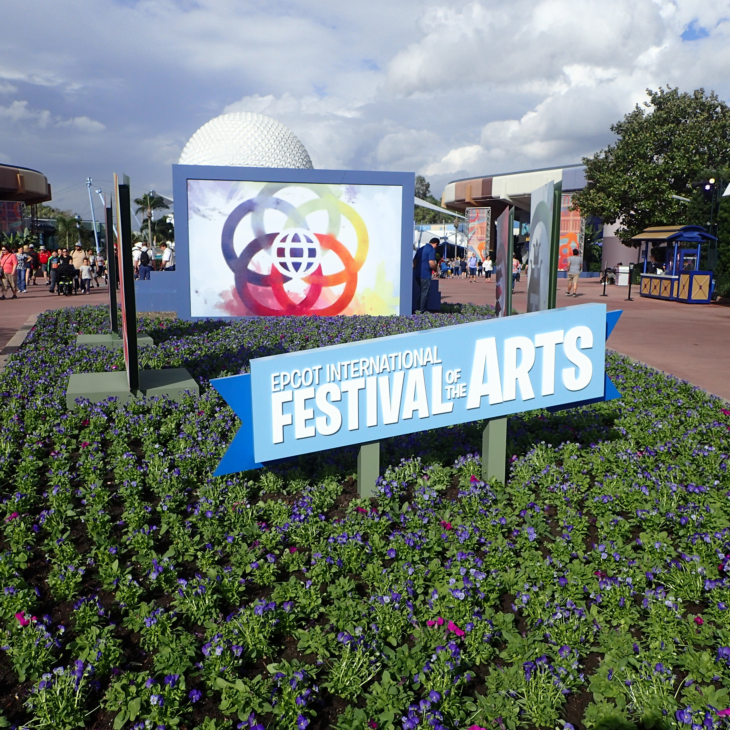 Magic Water, Living Statues, Pork Roulade – 7 Highlights at the Epcot Festival of the Arts 2018 signage