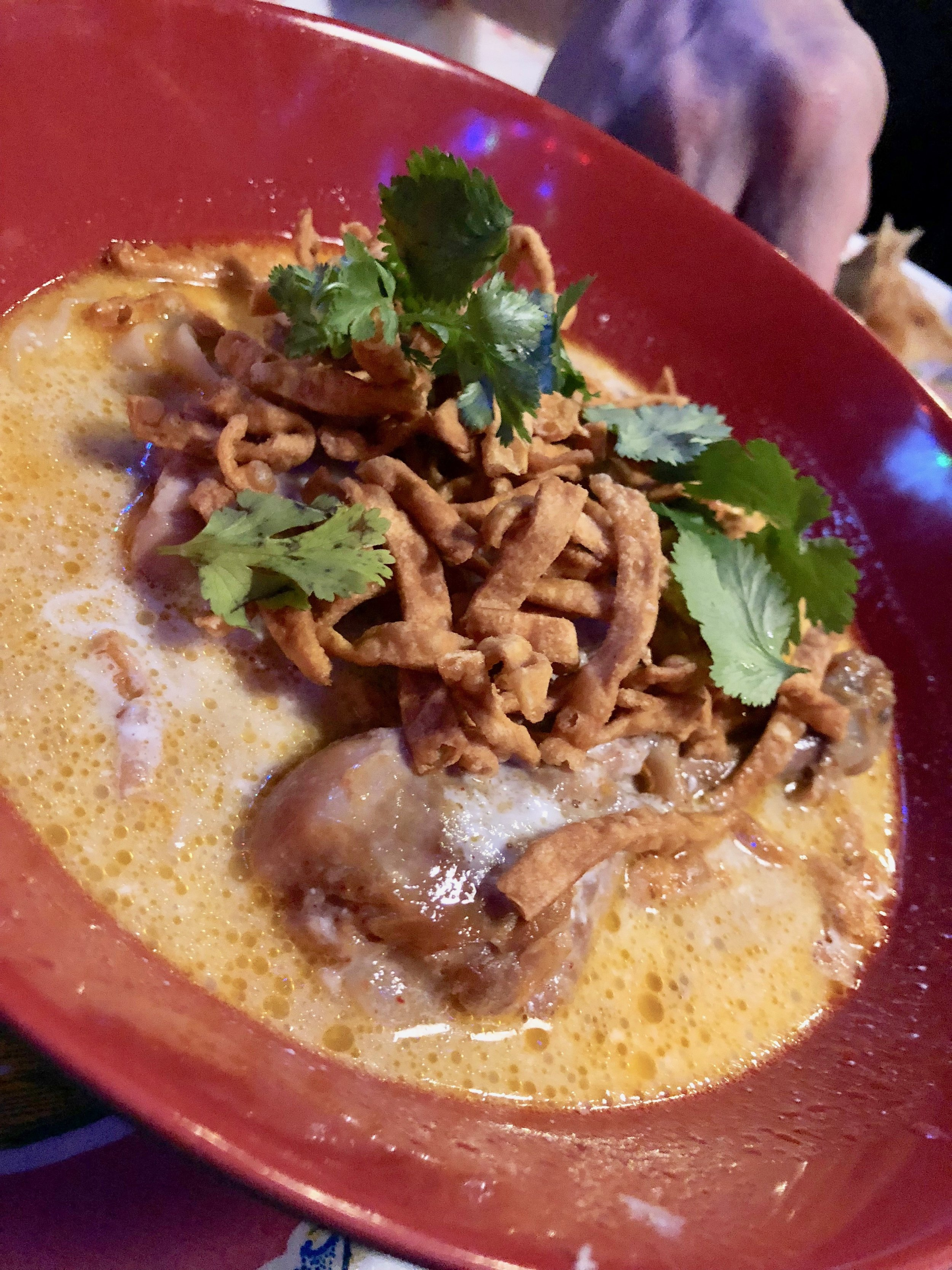A mild chicken curry soup called Khao Soi Kai at Pok Pok  I spot knuckles.