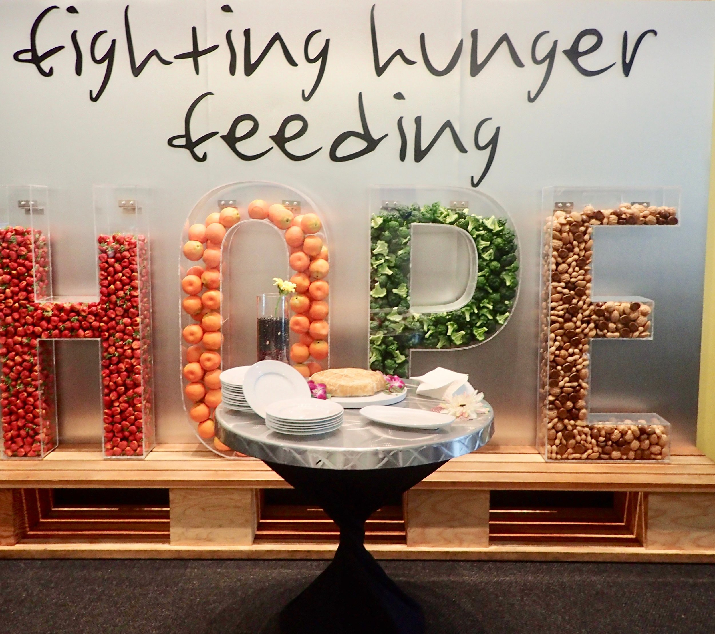 This lovely sign – the letters spelling HOPE filled with wholesome foods – is a fitting backdrops for receptions held in the Second Food Bank of Central Florida lobby. That's baked brie in front of the sign.
