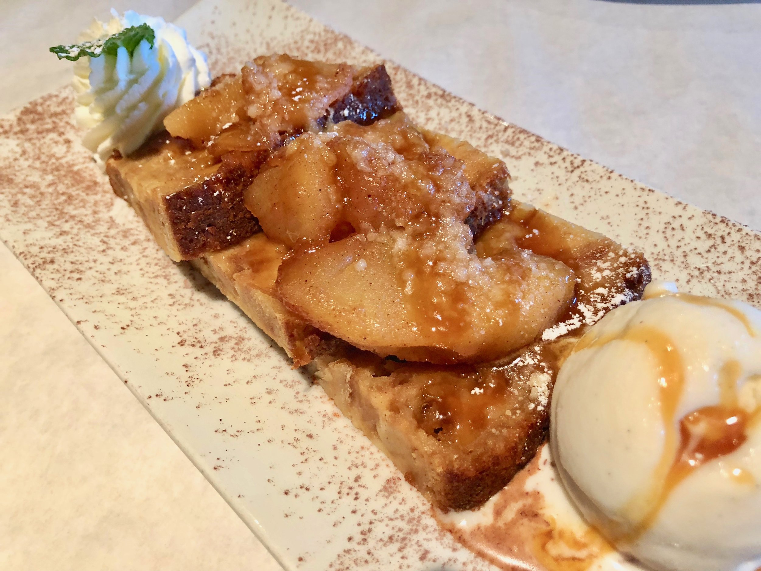 A wonderful dessert: 'Apple Pie' bread pudding made with braised cinnamon apples, salted caramel sauce, crumb topping and vanilla ice cream