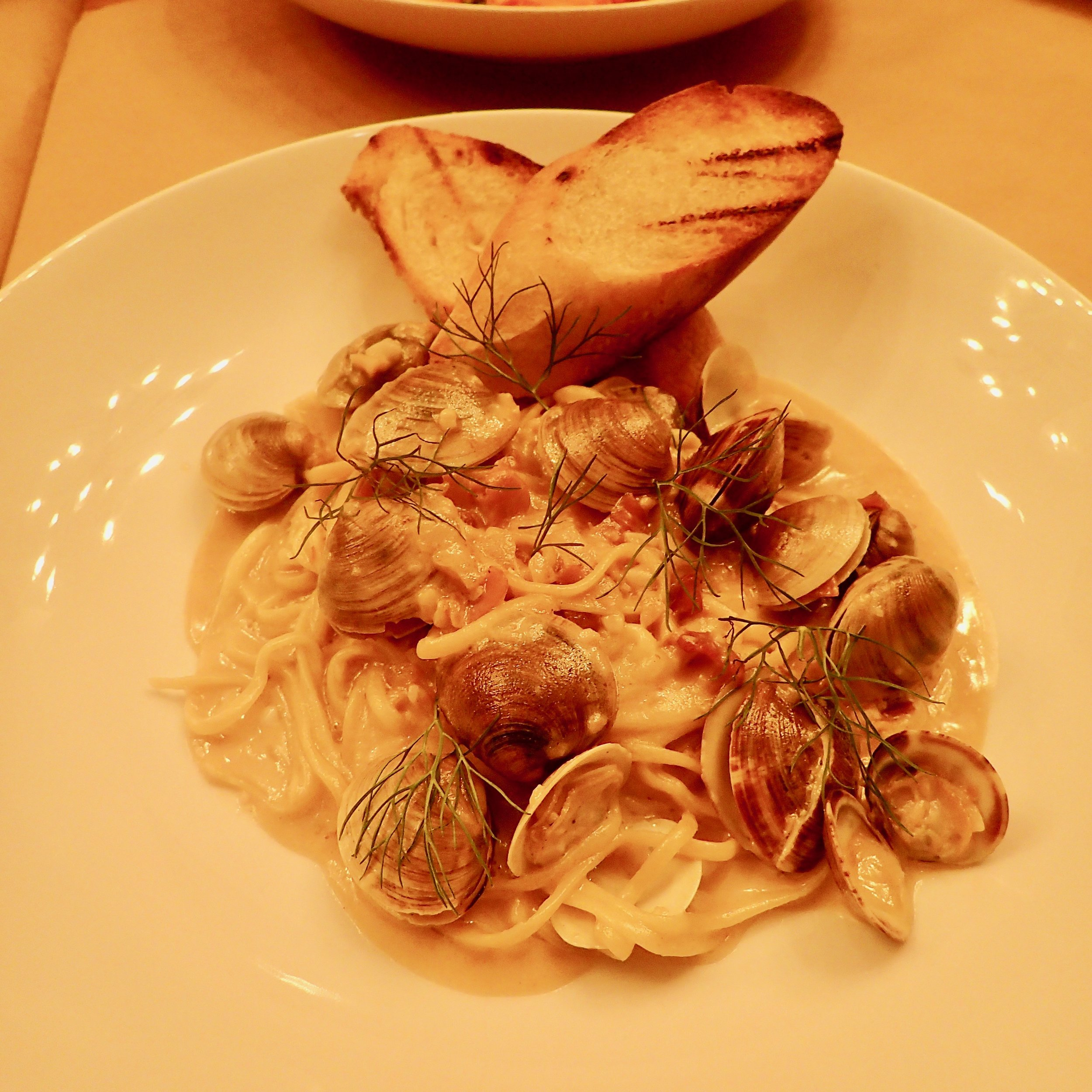 Housemade linguine with smallneck clams, pancetta, fennel and fronds in a lemon-white wine sauce at Sette Orlando.