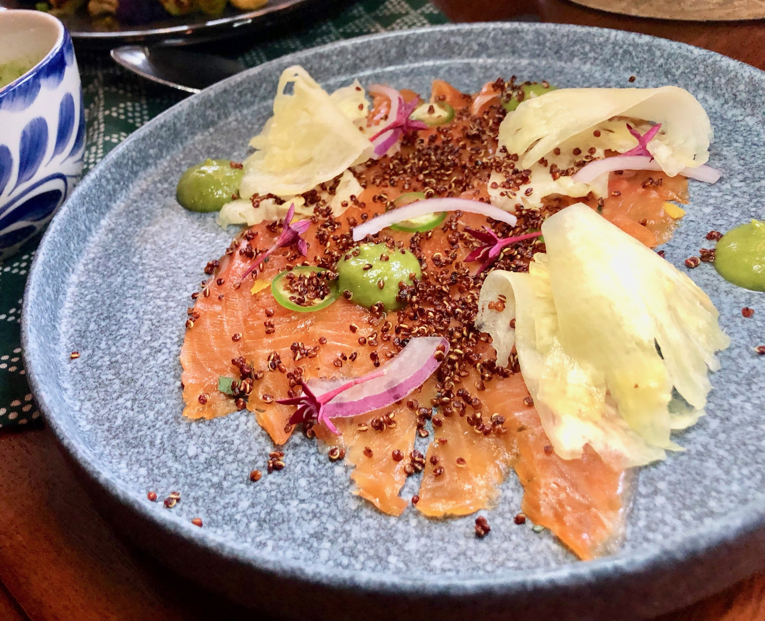 Reyes Mezcaleria – Arctic Char Aguachile. Essentially, this fish dish tastes like a good smoked salmon. It's served with pineapple aguachile – kind of a refreshing marinade, as well as puffed quinoa, avocado, red onion and serrano pepper.
