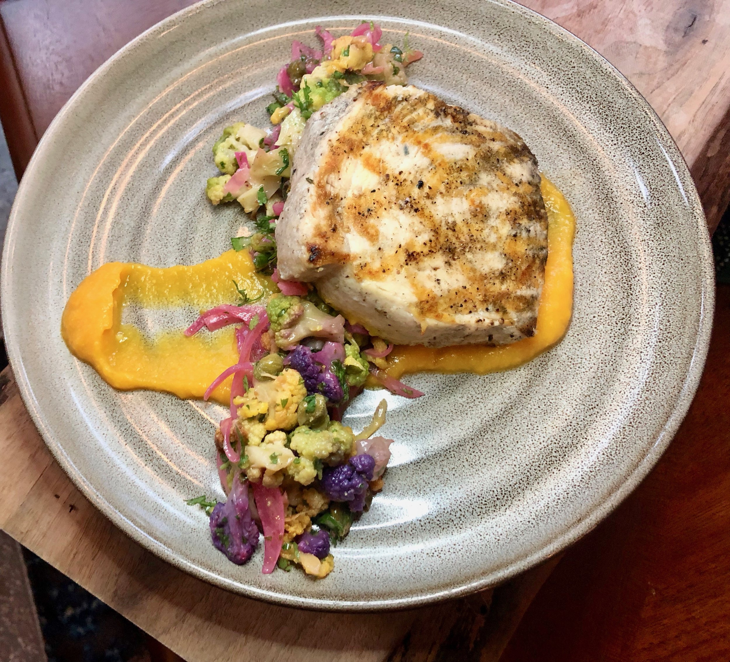 Reyes Mezcaleria – We lucked out having swordfish during our Orlando Magical Dining Month 2019 preview, but you prob can't go wrong. The Local Catch option is the day's white fish, pan-seared, with sweet corn puree and a rainbow cauliflower-caper-salsa.